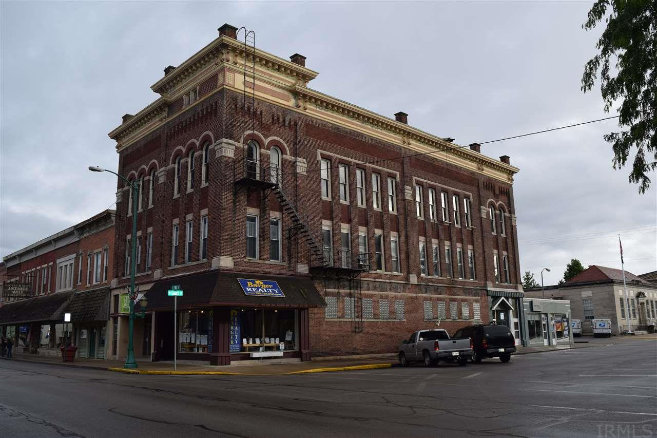 Location! Great downtown building with many possibilities.  Rentals already established with room for more!  The history still remains in this well cared for historical building.  At one time upstairs was a motel.  Five double rooms and a lobby remain.  Third floor was one time the theater area.  The building has a forth floor floored attic space.  Building pays for itself! Call Karen Barger at 260-748-2500 x520 for more details.