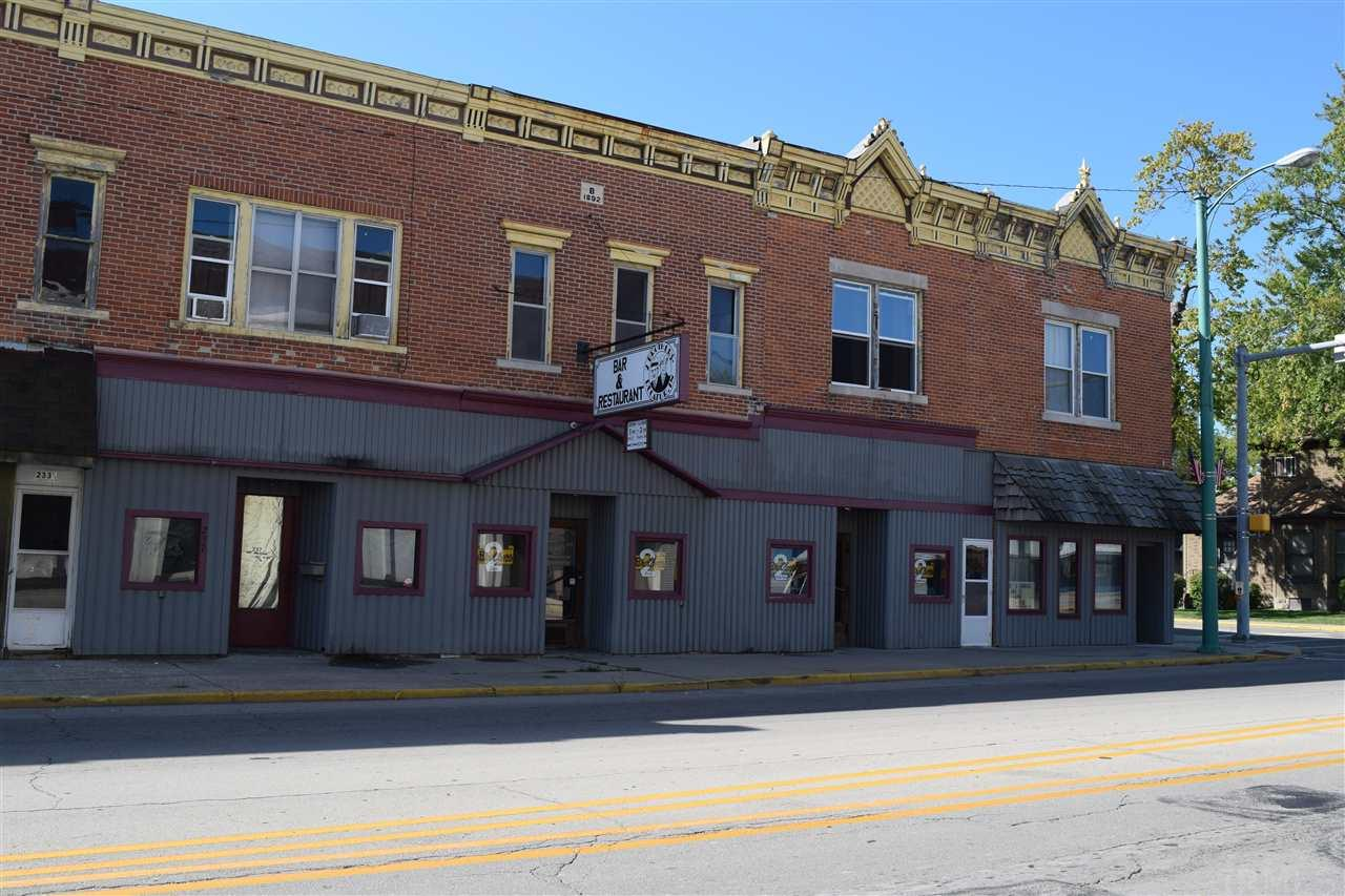Own a well established bar/restaurant business!  This building is huge and includes  four addresses! It can accommodate 150 people with a bar, family room and banquet room. There is a three way liquor license as well as a tobacco, pull tab and catering license.  All equipment as well as memorabilia stay with the property.  Upstairs features 7 apartments with 6 rented.  Income is $2400 to $2500 monthly.  Above the bar area is a owners living space/office in addition to the apartments.  This space has original woodwork.  This business has access to the city parking lot behind the bar.  There are sidewalk areas as well to install outside dining.  You get all of this and so much more.  Come see your new business today! Call Karen Barger at 260-748-2500 x520 for more details.