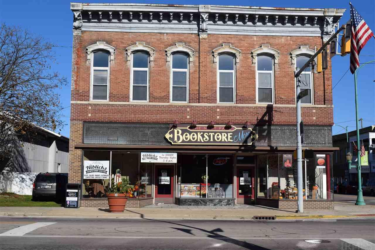 This is a unique building with unique opportunities.  This building was the original bank building for the city of Decatur.  It later became the Niblick's Building.  Niblick's was a general store, but so much more!  The current owners have renovated the building into a profitable business with a 3 bedroom 3 bathroom flat above to live in.  The Next Page Bookstore is a cozy place to browse and buy books.  There is rental space in front of the bookstore for a restaurant/coffee shop.  All the equipment for the restaurant area is included in the sale.  There is additional rental space in the rear of the building with storefront on 2nd St.  The flat upstairs is a beautiful home. All the cabinetry has been built with repurposed wood from the building.  There are three levels of decks for the family upstairs as well as a play house with it's own balcony.  The Niblick's name is also included in the sale. This is a great building!  Call today to see it!