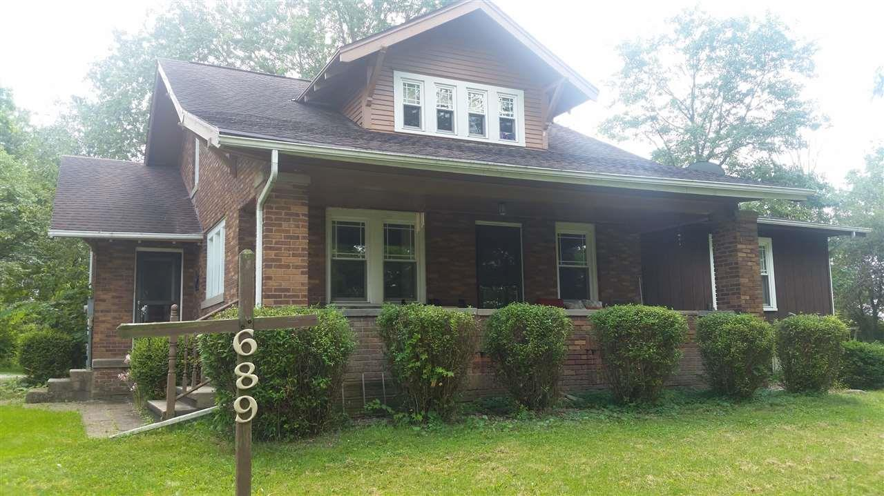 Wow! Your chance to own this classic style home featuring the best of the both worlds... the original all brick home dates back to 1930 and features craftsman style details and a great front porch, inside you will find amazing trim, and lots of space.. in addition you will find a quality addon that included a Large Familiy Room and Master Suite!... All on a beautiful 2/3 acre lot close to town but in a quiet peaceful location off Lincolnway near the Whitley County Fairgrounds... Don't miss your opportunity to tour this well maintained Columbia City classic home.. one view and you will want to make it your home! The city is in the process of constructing a sidewalk for connectivity and walking...This Property is a ImagineSelect Property Pre Inspected and includes a 18 month Warranty for your peace of mind.