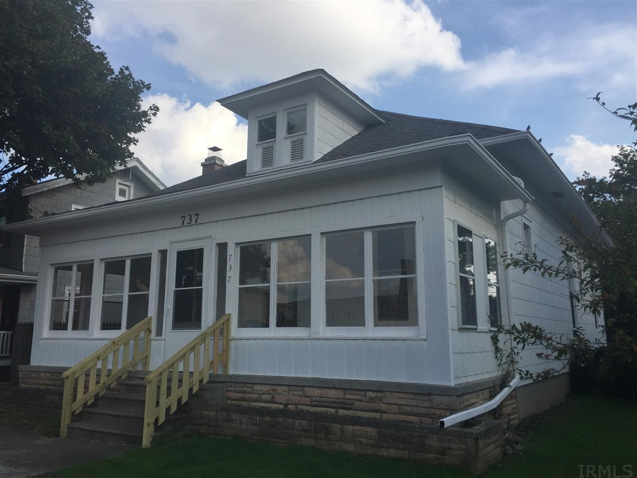 Totally Updated and Refreshed in 2017! Classic Charm in a well established neighborhood, conveniently located close to Downtown, Franke Park and Zoo, and all things Fort Wayne! From the quaint brick paved street and views of steeples to the large enclosed front porch, detailed woodwork, painted wood floors and remodeled kitchen & bath one look and you will fall in love! Ready for quick closing this home is a real gem!