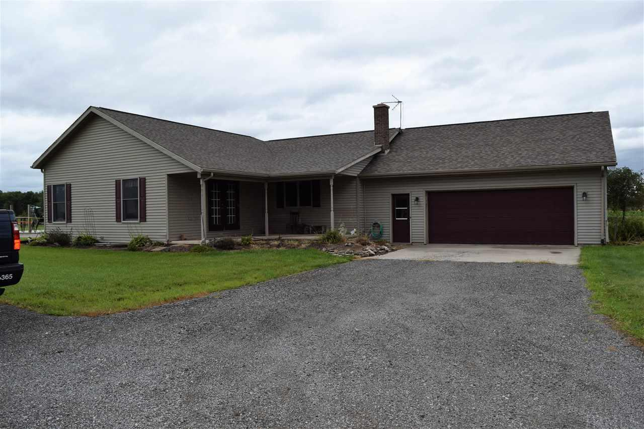 Like new ranch on a finished basement with 4 bedrooms and 2 full bathrooms and 2 half bathrooms.  Property sits on a little over 5 acres.  Nice deck with hot tub that stays. Fresh paint in the master bedroom and laundry room.  Roof new in 2012 when addition was added.  House is all electric with a $189 year round budget.  Heat source is geothermal with a heat pump for the addition. Ringer water softener with an iron filter is also recently new. Property has 2 sump pumps with battery back up. Also features 13 ft Cathedral ceilings in the living room.  Home also has two laundry hook ups on the main floor.