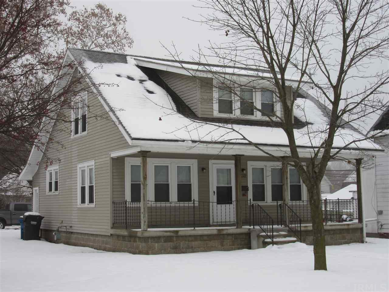 Come home to charm and lots of space! Lovely 4 bedroom 1 bath home in great condition over a spacious modern basement that is ready for your finishing touches. Original hardwood floors and lots of windows let in tons of natural light!  Enjoy the sunset at dinner with windows on two sides! Full width front porch allows the same enjoyment of simpler times. Large private driveway for off-street parking.. corner lot located ideally close to downtown conveniences. Come see it today won't last long!