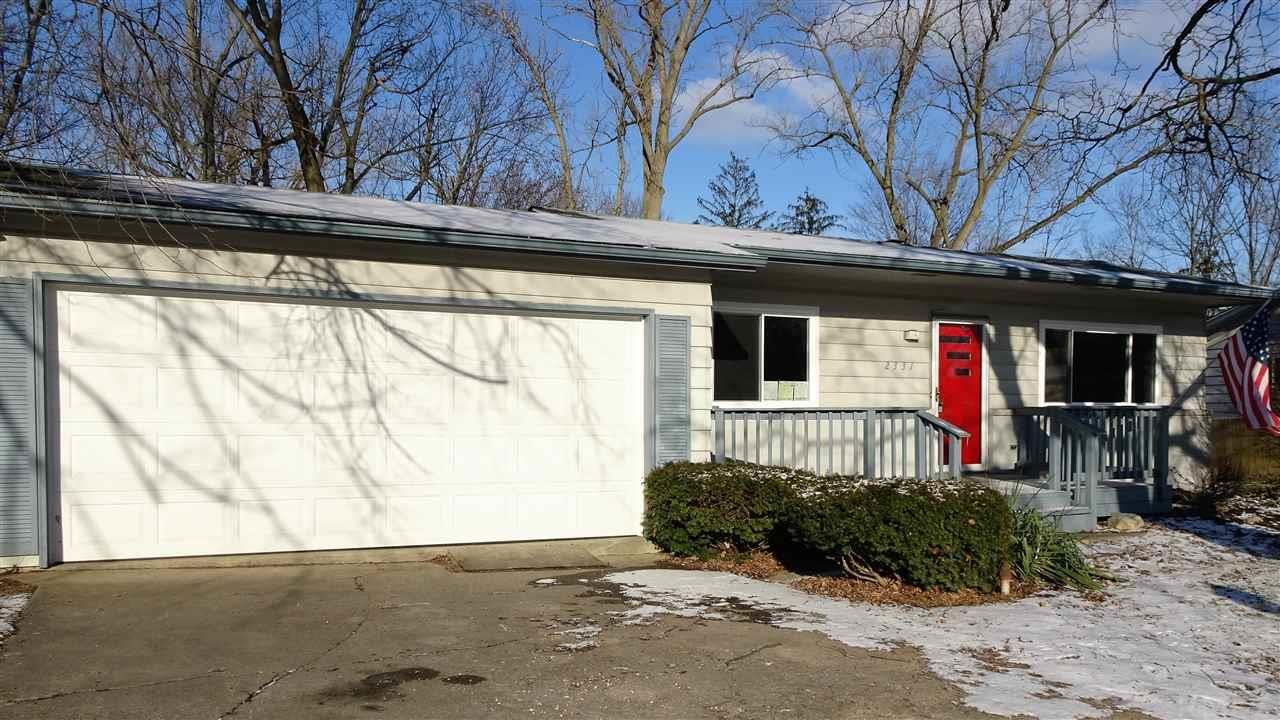 Spacious and attractive Mid-Century style Ranch on a full finished walk-out basement, in the popular Concordia Gardens neighborhood.  The lot backs up to the neighborhood park which you can see from any of the back windows of the home.  Great location that is close to schools, stores, eateries, Glenbrook Square, NW and NE Allen County, as well as, a quick drive to downtown.  This home has been tastefully revived inside and out, with popular colors and styles kept in mind.  There are new Hoosier Windows and Doors that come with a Lifetime Transferable Warranty.  New HVAC system (ducts, vents, and both units) with registration papers for new buyer's warranty.  New sleek black side by side refrigerator/freezer with ice/water in door and built in oven in main kitchen.  There is new landscaping front and back, and a beautiful burning bush that blooms bright red to add to the curb appeal.  The new furnace is located in the hallway attic and the air flow filter is also accessible from a new vent in the hallway ceiling.  The new AC unit is on the East side of the home (to the right side-if facing house).  This home will be great for entertaining, as well as, a large, blended, or multi-generational family.  There's over 2500 square feet of living space with two kitchens, two large bathrooms (one on each level), potential for 5 bedroom spaces or offices in the lower level, and two living rooms each with their own wood burning fireplace.  Go and See right away!