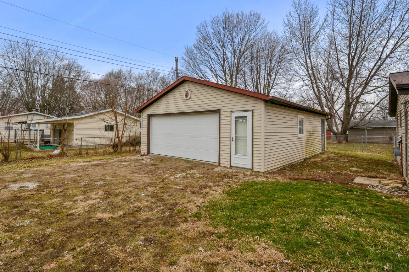 Updated three bedroom, one bathroom home in Indian Heights. This 960 square foot home has an open floor plan and a spacious eat-in kitchen. Recent updates include: flooring, paint, and lighting. Taxes in Beacon reflect no exemptions. Property taxes would be approximately $630 annually for an owner occupant.  The backyard is fenced with an oversized 32x24' (768 square feet) garage that would be perfect for a workshop or storage for multiple vehicles.