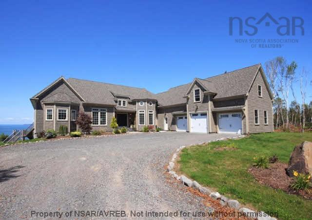 This stunning oceanfront estate has been immaculately finished throughout the 6,318 sqft of finished living space. The 3.6 acre grounds offer absolute privacy and spectacular views of the Bay of Fundy with 259 ft of direct ocean frontage. The custom finishes within this beautiful home need to be seen to be fully appreciated with fine European styles and quality craftsmanship. The to-die-for open concept kitchen is a chef?s dream and a great space for entertaining. Imagine the fabulous cocktail parties you could throw at this sensational property! The gigantic master suite offers a spa like retreat with nothing but the sound of the ocean to help you relax. The large indoor lap swimming pool offers stunning views of the ocean, picture yourself swimming a few lengths whilst looking out at the Bay. This extensive home also includes 3 guest suites, a library, rec room, a climate controlled wine room and much more. The stunning location and finishes throughout this home would make for a wonderful B&B or luxury Spa. Call to arrange a private showing of this elegant home.