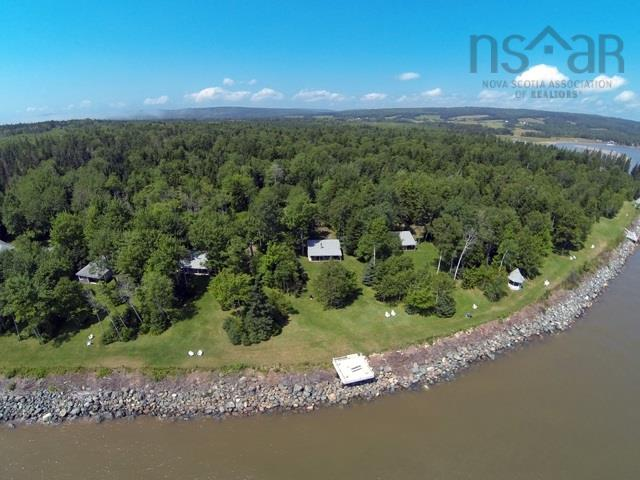 A once in a lifetime opportunity to own your own business and have a wonderful life style.  This retreat has been in operation for over 25 years.  The property encompasses over 1200 +/- ft. of direct oceanfront on Cobequid Bay.  This opportunity consists of an upscale Owner's Private Residence, a 3-bedroom Manager's Home, Three (1)-Bedroom Cottages, Six (2)-Bedroom Cottages, One (3)-Bedroom Cottage, a Meeting Centre (with 2 bedrooms) office and workshop building, wood house machinery building, pool, hot-tub, and fabulous garden and fruit orchard.  All this is located on 30 + acres.