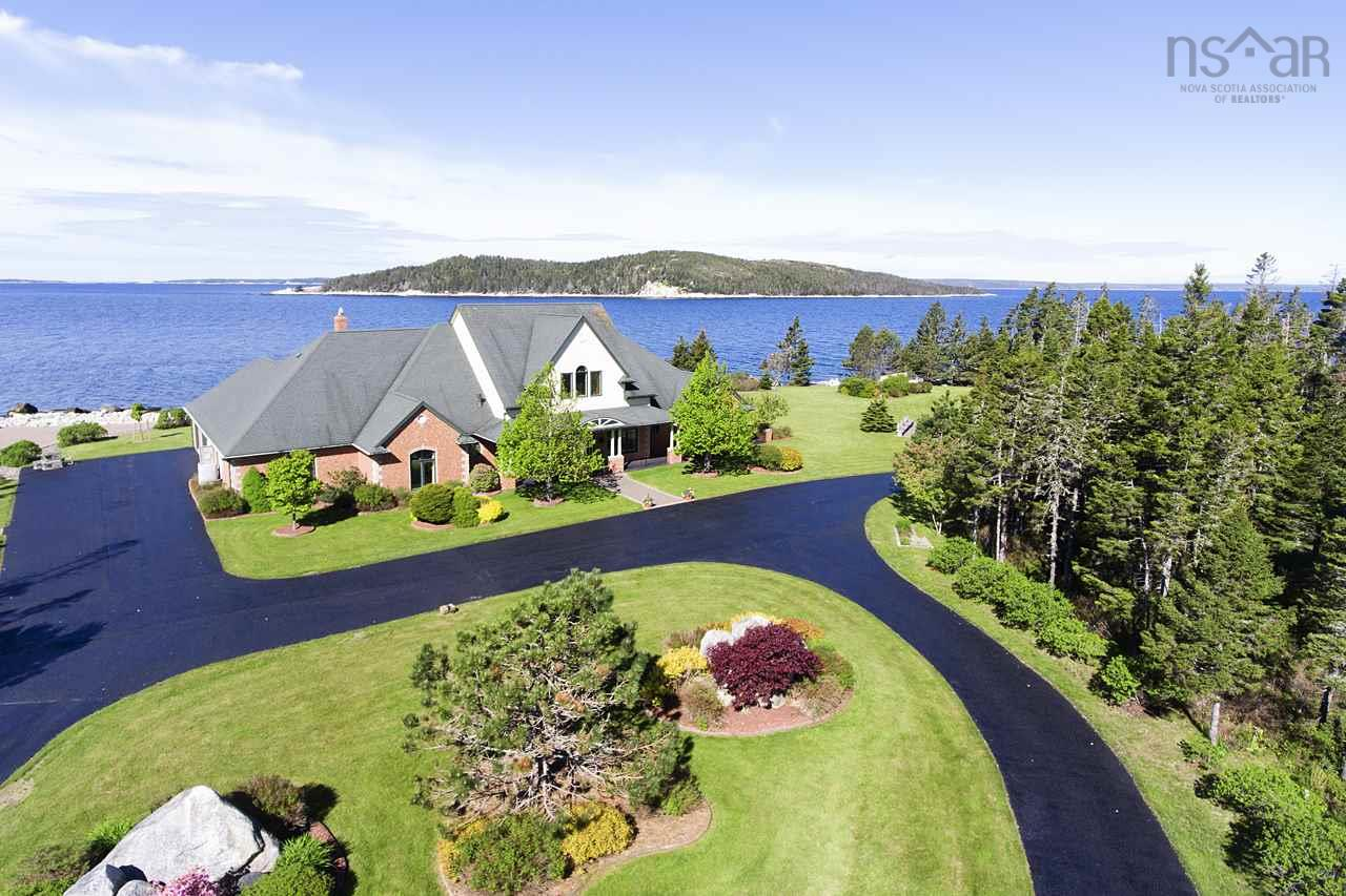 This spectacular estate ranks among the finest oceanfront properties in Nova Scotia.  With 11.78 acres and 520 ft of pristine shoreline, it offers both luxury and privacy.  The ocean views are stunning and the setting is truly serene. Relax on the sun decks, covered patios or in the gazebo.  Stroll around the colorful gardens and manicured lawns. Enjoy a picnic of locally caught lobster or a game of volleyball with family and friends on your private beach. Watch the sailboats pass by and catch a glimpse of the seals, porpoises and other marine life.   Top it off enjoying a magnificent sunset while listening to the gentle sound of the surf.   The 4900+ sq.ft.  custom-built home was meticulously designed and constructed. Beautiful finishes and high ceilings throughout evoke a sense of grandeur. Bright cheery rooms bring the outdoors in.  The home has an exhaustive list of top-of-the-line features.  From the dream kitchen with high-end appliances, to a master suite and dressing room beyond compare, to the amazing wood-paneled study, no detail has been overlooked.  Just 25 minutes to Halifax and 40 minutes to Halifax International Airport, this property is a must-see.