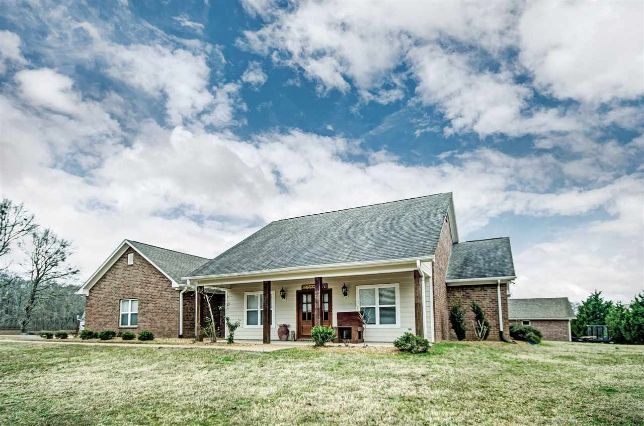 Peaceful Country setting!  This home in located in Yazoo County just outside of Benton.  It features a split floorplan with 4 bedrooms.  As you enter through the front door you notice the open floor plan.  Off the foyer is the formal dining room and the den is just beyond.  The den is open to a spacious kitchen complete with stainless appliances, granite counter tops, breakfast area and a large walk-in pantry.  The master suite is a large bedroom complete with an extra area that can be used as an office or a reading nook - a spacious master bathroom and a large walk-in closet. The other bedrooms are on the opposite side of the home and one of them has an extra sitting area that can be used for several things.  The outside features a nice screen porch overlooking the backyard.  Just a few steps away from the screened-in porch is a workshop that built to complement the home and provide plenty of storage and work space.  Call you agent today - homes like this are a rare find!