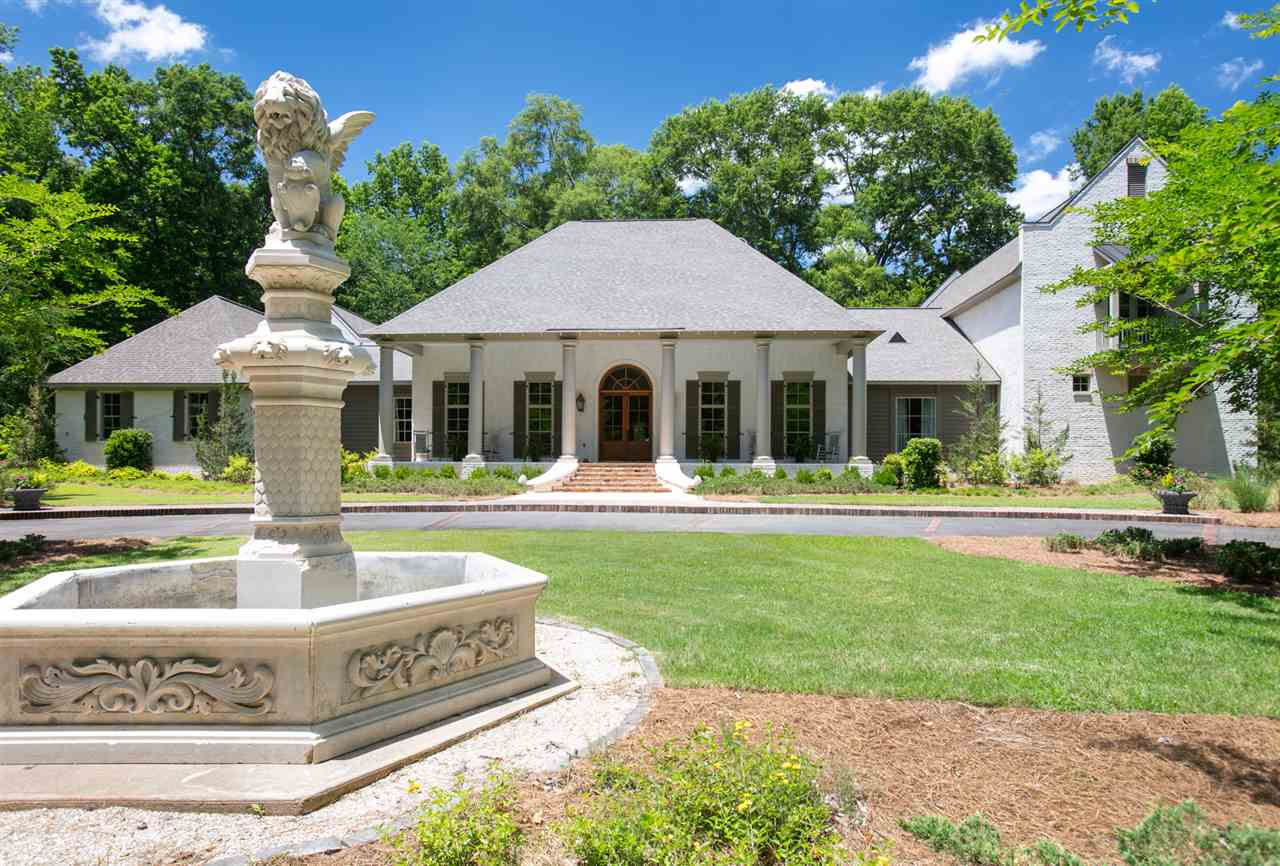 Classic Southern style in this stunning secluded estate filled with custom amenities. Close to everything, but away from it all in a prime location in a private gated cul-de-sac attached to Southern Oaks subdivision.  Five bedrooms and 5 1/2 baths plus three balconies on 12-plus acres.  The kitchen is a chef's dream with a generously sized keeping area, plus a walk-in pantry and mudroom.  You will love the library with it's full wall of custom built-in bookshelves and cabinets.  Formal dining room with large butler's pantry and a walk-in china closet.  Master bedroom features and adjoining sitting room with French doors and floor to ceiling windows that look out on a private rear patio. Custom details in the master bath include marble floors, counter tops, soaking tub, marble tiled shower with spa jets.  Also, on the first floor is a powder room, media/office space, and two guest bedrooms.  A staircase with hand-wrought iron banister and heart pine steps lead you to the second floor with a den, and two large guest suites each with their own balcony. Don't miss the amenity filled four car garage, which includes a two-story shop.It includes an upstairs man cave (630 h/c sq ft), a single garage (shop) & a full bath (895 h/c sq ft) & downstairs storage (89 h/c sq ft) that is in addition to livable area of the home.This heated & cooled area is 1,614 sf. That makes a total of 9,275 sf. The magnificent view from the back of the house is of a lush landscape complete with a private lake. The outdoor details are as striking as those indoors, with a copper-roofed barbecue area, a front fountain, a rear wishing well, and an additional storage building with a dog run. The gunite pool features a natural stone waterfall, and the large pool house contains a refrigerator, a stainless grill, a functional fireplace, and a full bath; there's even a closet for an ice machine and an area for a laundry hookup This is an additional 826 sq. ft. heated & cooled. The entire pool area is surro