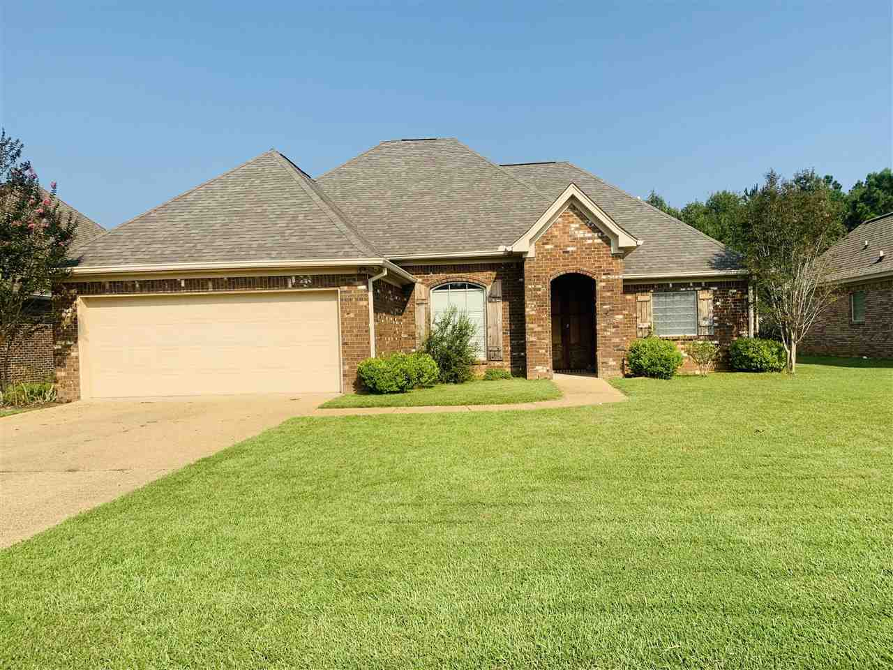 Move-In-Ready home awaits you in the City of Florence, Rankin County, MS. This lovely home is located in the highly sought after, Copper Ridge subdivision. The home features semi-open concept with 3/2 split floor-plan. The large owner's suite offers great privacy,  tall bay windows, double walk-in closets, double vanities, separated shower, jetted bath tub. Open formal dining room with tall windows flows to spacious living-room with a fire place, large break-fast room with bay windows. The spacious galley style kitchen offers handsome Viking appliances, gorgeous granite counter top, xtra cabinet space, eat & go breakfast nook. The interior is coated with fresh New paint. There is NO carpet: 3 bedrooms have New laminated wood floor and the rest is tiled. The spacious, covered back porch over looks a peaceful green area, and the leveled back yard is embraced by wooden fence for your privacy. The roof is New, HAVC unit is only 2 yr young, and Tankless water heater is only 1 yr young. Hurry come look at this Lovely home Today!