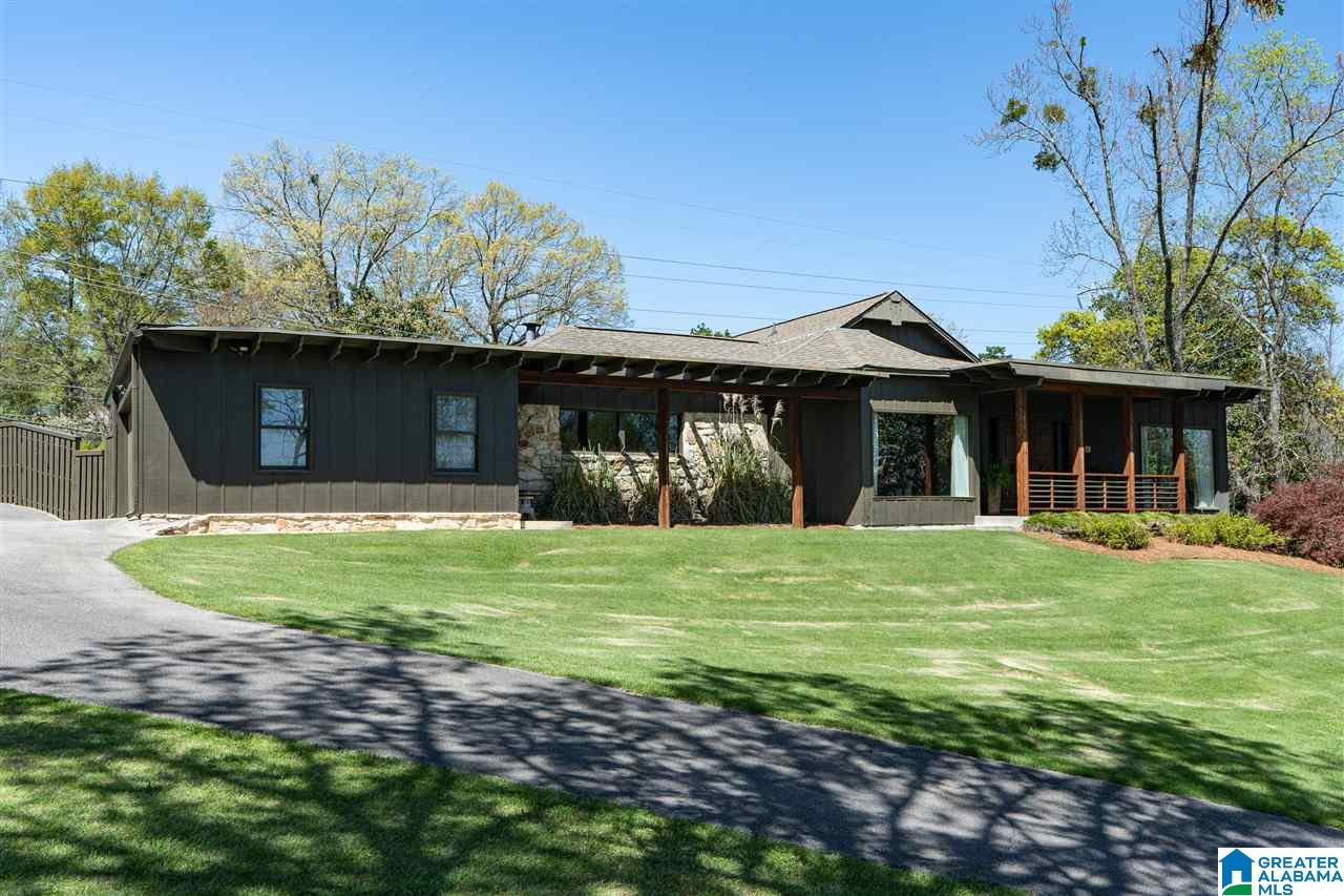 "This is a true Mid-Century Modern GEM! This home sits on a large corner lot in the heart of Brookwood Forest. The main level has beautiful slate flooring, a large den that has sliding doors opening to the pool and patio, living room, large dining room,kitchen that opens to the pool and a desk/office area in the kitchen - so much natural light - it's incredible! The master bedroom is on the main level and also opens out to the pool area. The master bathroom has ""his"" and ""hers"" separate vanities and closets. There is a sitting room off of the master bedroom that can also double as a private home office. The full bath off of this office area has been updated (and featured in Lowe's magazine) and is the perfect spa/pool retreat. The full finished basement has a LARGE den and wet bar and includes a murphy bed for extra guests, separate entrance from outside, a full bathroom and a bedroom which has another murphy bed! Tons of storage space! THIS IS A COOL HOUSE!"