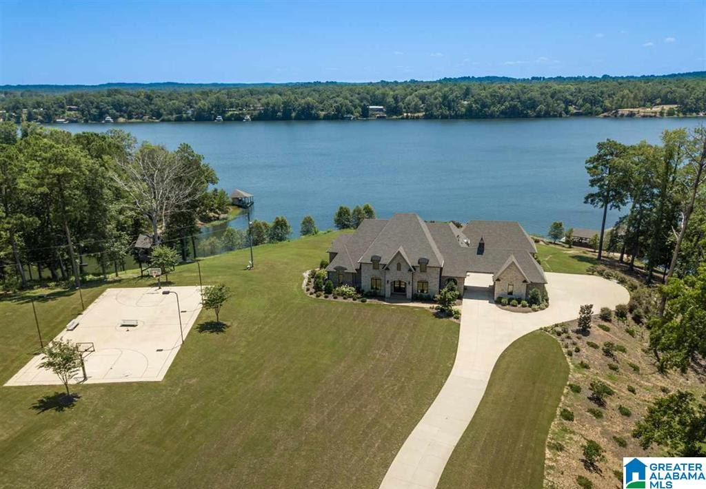 This immaculate home on Lake Tuscaloosa's Main channel was custom built in 2016. Enjoy the privacy of this 7.56 acre private gated estate with spectacular panoramic views with 1355 feet of lake water frontage. Luxurious master suite with fireplace on the main level. The gourmet viking kitchen has it all with a large island and breakfast bar area that faces the lake. Theater, rec room, gunite chlorinated pool, hot tub, dry sauna, open deck/partially covered patio, and boat house. Tree house has A/C unit. Security gated entry to property.