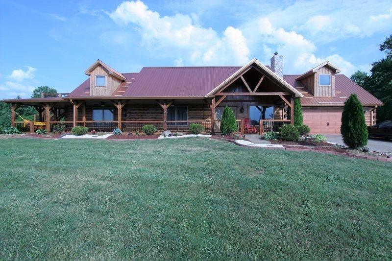 Nestled on a hilltop just North of Jasper is this 3690 sq. ft. massive log home. Features include 4 gigantic bedrooms, 3 full bathrooms, and a 2 car attached garage. The main floor master suite is enormous and offers an electric fireplace a built-in TV, french doors that open to a covered porch, an adjacent master bath with a large tiled shower, a jetted tub, and double bowl vanity, as well as a walk-in closet. The open concept great room, kitchen and dining room are fabulous and feature hardwood floors, a wood burning fireplace, a large L-shaped bar,  tiled back splash, and stainless steel appliances. The open stairway leads to level 2 which offers a large guest bedroom with and electric fireplace and bath, and walks out onto a 12X14 deck with spectacular views, a spacious bar/serving area, a Rec/game room, and a theater room complete with 8 theater seats, a projector and screen, mini fridge, and microwave.  This scenic property is beautiful and spacious and has aggregate wrap around porches, patio,  and walk ways, a covered hot tub area, a 2nd story raised deck,  and lots of character.