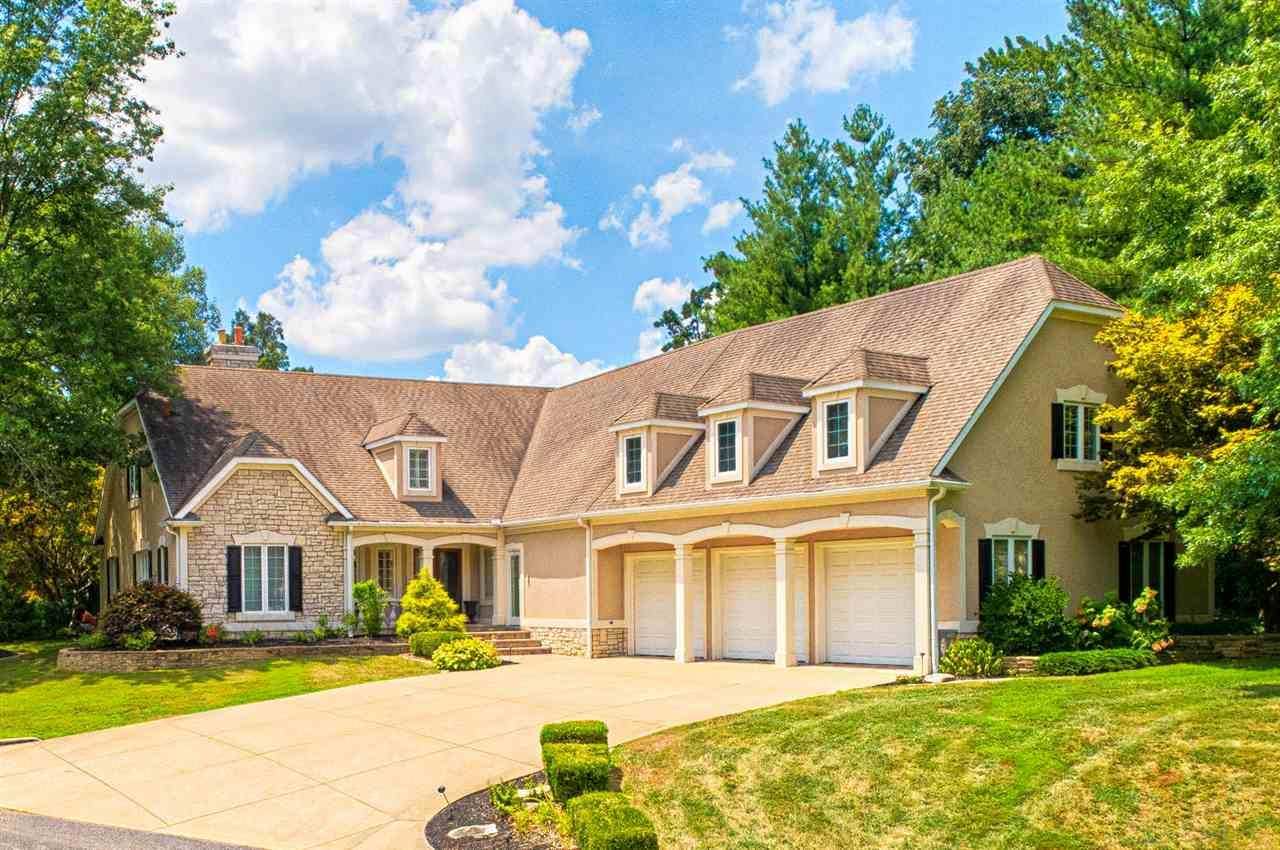 Situated on 2.35+/- acres on Lake Talahi in McCutchanville this impressive home offers outdoor enjoyment and beautiful views with inground pool, extensively landscaped patios, dock, and fire pit. This exquisite home is loaded with amenities and recent updates including custom woodwork, hardwood flooring, marble floors, renovated kitchen, replacement windows and more. The gorgeous entrance and spacious foyer with soaring ceiling welcome you to this wonderful home. The living room with crown molding and fireplace is open to the dining room. The stunning kitchen was totally renovated with modern elements and lavish details including an abundance of cabinetry, large island, marble counter-tops, Wolf 6 burner stove with double griddle, double ovens, pot filler, double farm sink, Subzero Thermador refrigerator, and beverage center. The luxurious kitchen opens to a large dining area with fireplace perfect for family meals. The spacious great room with built-in entertainment center offers floor to ceiling windows providing stunning views and access to outdoor patio space. The spacious main level master suite with custom ceiling offers a large master bath with custom tiled shower and double sink vanity. The main level also offers a large laundry with cabinetry, guest bath, and recently added mudroom with custom built-ins and workspace located off the large 3 car garage. This 5 bedroom, 5.2 bath home has a second level with a spacious bonus room. This room offers a billiard area, game room, large bar, area perfect for theater and a full bath. There is also a large open den with built-ins, 4 bedrooms, and 2.5 baths. The walkout lower level offers a kitchenette off pool with serving bar with seating, rec room currently used for exercise, full bath, and laundry. The grounds and views this home offers year round on Lake Talahi are truly serene making this property a unique opportunity in a highly desirable area.