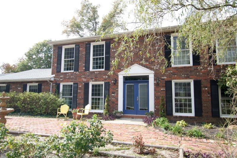 Motivated Seller! Price & Acreage Reduction!  There's plenty of room to roam inside and out on this beautiful secluded property located in Huntingburg. The outside of this colonial brick home is a treat all its own.  Beautiful landscaping and trees, children's play set, 3 car detached garage with finished attic office space complete with AC and plenty of storage.  Upon entering the home, the two-story foyer will catch your eye with abundant natural light, marble floors and a grand spiral staircase. The main level offers space for everyone. The heart of the home resides in the kitchen.  Warm granite counter tops, wood plank floors, decorative lighting and custom cabinetry makes it both functional and fun.  A spacious family room with gorgeous fireplace creates the perfect spot to relax at the end of the day.  You'll also find a cheerful dining room, half bath and a cozy sitting room with its own updated fireplace.  Large master bedroom and full bath with plenty of closet space completes the main floor.  Head upstairs and you'll be pleased to find a second master bedroom with full bath and walk in closet.  In addition, two nice sized bedrooms, full bathroom, and plenty of closets.  In the recently waterproofed, walkout basement/man cave, you will find that perfect spot for watching your favorite sport.  A bonus room with closet, laundry room and built-in storage completes the package.  Be sure to schedule a showing today and see for yourself!
