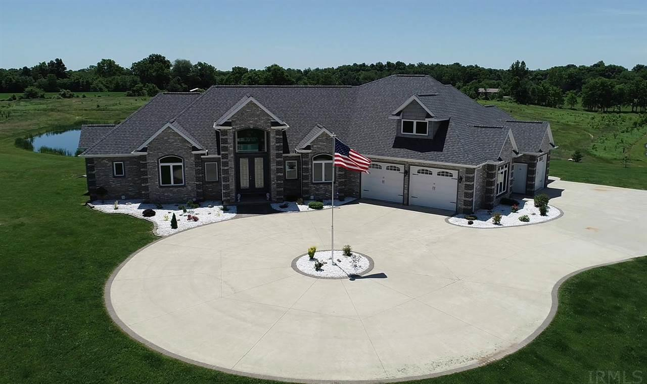 "NEW PRICE! This amazing 6000 SF executive style home is just minutes from Fort Wayne, Aboite, Warsaw and Grable, and sits on 17.5 rolling acres. Words can't describe the charm and elegance of this one of a kind home. Even the pictures have a hard time capturing the grandeur of the 20' vaulted ceilings or the 10' water wall upon entering through the 8' tall double door main entrance. The list of features is too numerous but some of the highlights are: Dual Geothermal, 7 zones total. 1,200 SF 4 car heated attached garage, 1,133 SF concrete patio. 800 SF composite deck with vinyl railing. Sound system throughout  1st and 2nd floor with individual volume control. 10' ceilings in basement. Granite counter tops in main kitchen, cherry cabinets, dovetail joints, soft close doors and drawers, dual sinks, pot filler above stove, one touch faucets, stainless appliances. Kitchen in basement has granite counter tops, dovetail joints, soft close doors and drawers, one touch faucets, stainless steel appliances and lighted shelving. Master bath has a jetted tub, dual sinks, and a 5'x9' tiled shower with 4 body sprays, 1 rain shower head, and 2 regular shower heads.  6"" stained cherry baseboard and 3.5"" cherry trim throughout. Central vacuum with toe kick sweeping throughout house and garage. Huge 133'"" screen in theater room with 6 powered theater seats and plenty of room to seat 10+ more. 100+ trees planted approximately 4 years ago. Safe/Bonus room approximately 100SF. Walk Out Basement Features: theater room, pool table, kitchen, bar area, walk out bedroom, TV nook, workout room, 2nd laundry room, storage room and full bathroom. Just under 2 acre pond is new this year. Located on a quiet country road within 30 minutes of all the entertainment and areas of interest NE Indiana has to offer. Just a short trip to Lake James, Dallas Lake, Barbee Lakes, and Wawasee, or travel to Aurburn, Aboite, Fort Wayne, Warsaw, Grable in under 30 minutes. This is a home you truly have to see to appreciate."