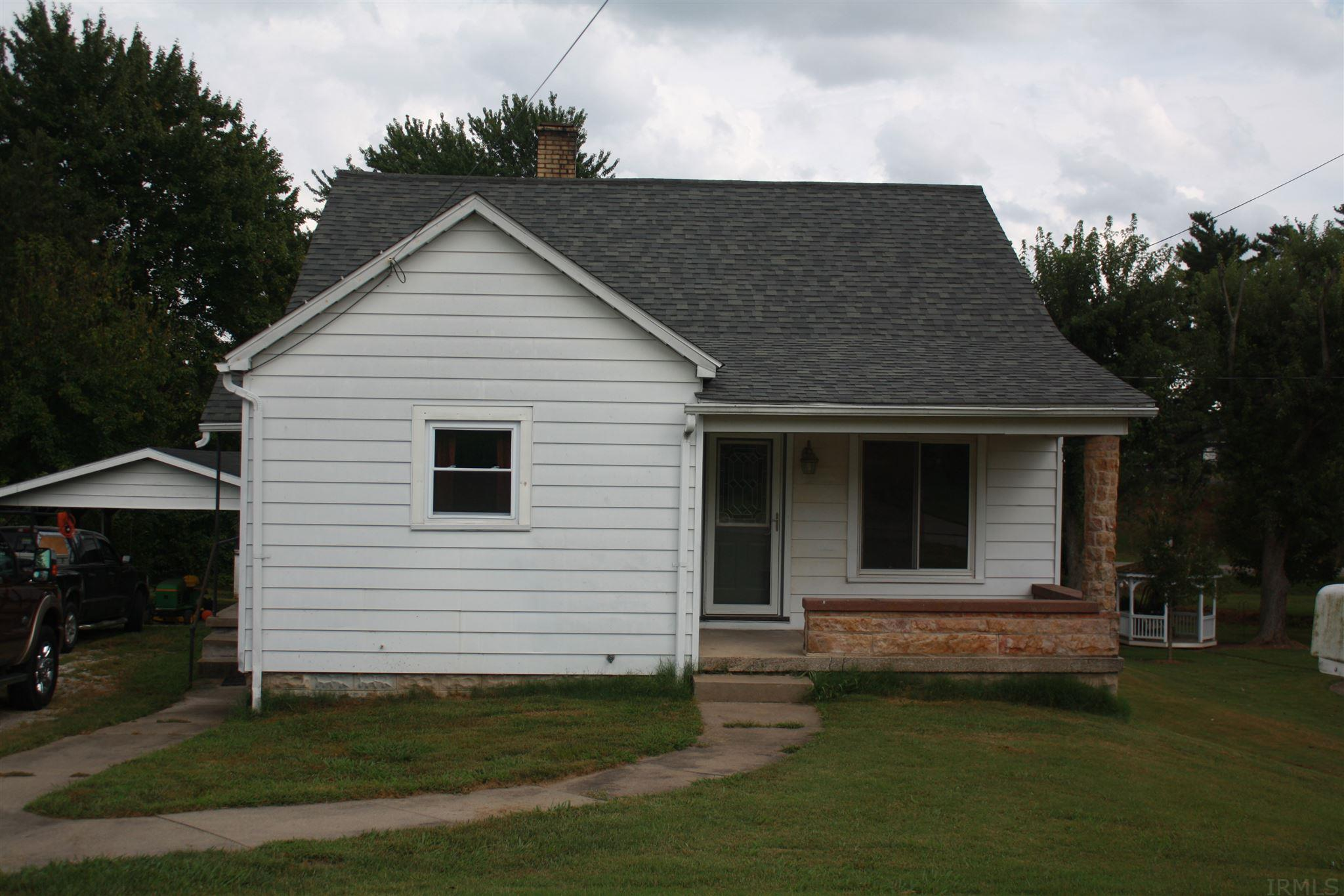 This home is full of character. It has original hardwood floors that have been refinished, new double hung windows in most of the house that have a lifetime warranty, new front and side doors, and huge closets throughout the house. HVAC system is only 6 years old and has a hypoallergenic adapter included. This home even comes with a 32 inch cut John Deere riding mower. The Stone used on the front porch is original stone from the historic St. Meinrad Archabbey. Make this your home today!