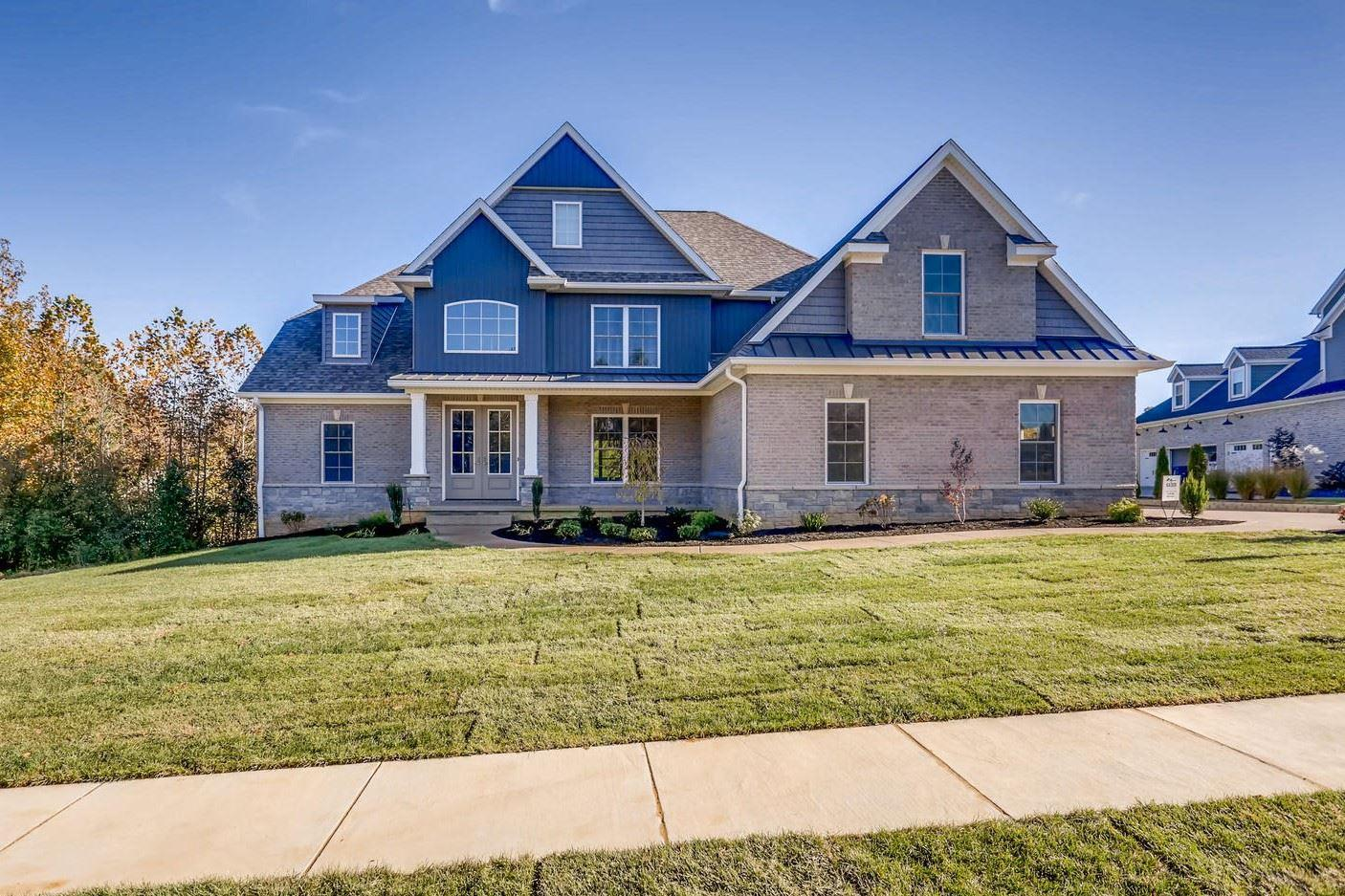 Remarkable 5-bedroom, 4-bath home, with bonus room, located in Woodfield Subdivision built by 2018 Parade of Homes Winner Corey Hirsch Construction. Meticulously crafted with 4270 square feet of living space, this sunlight-drenched open floor plan offers a welcoming, 2-story foyer which pulls you into the great room with picture windows and a gas fireplace, a beamed ceiling, and spectacular views. The gorgeous eat-in kitchen boasts an over-sized island with seating, glass back splash, dining nook, walk-in pantry, gas cooktop, and stainless appliances. The main-level master suite offers lovely views and a spa-like master bath with a tiled shower, dual vanities, a spacious walk-in closet, and decorative lighting. The main level also offers a second full bath, a guest bedroom, laundry room with built-ins off the garage, and much more. Upstairs you will find three additional bedrooms, two full baths, and a wonderful bonus room. The spectacular outdoor living space offers you a large patio, beautiful views of the property, and lush landscaping.