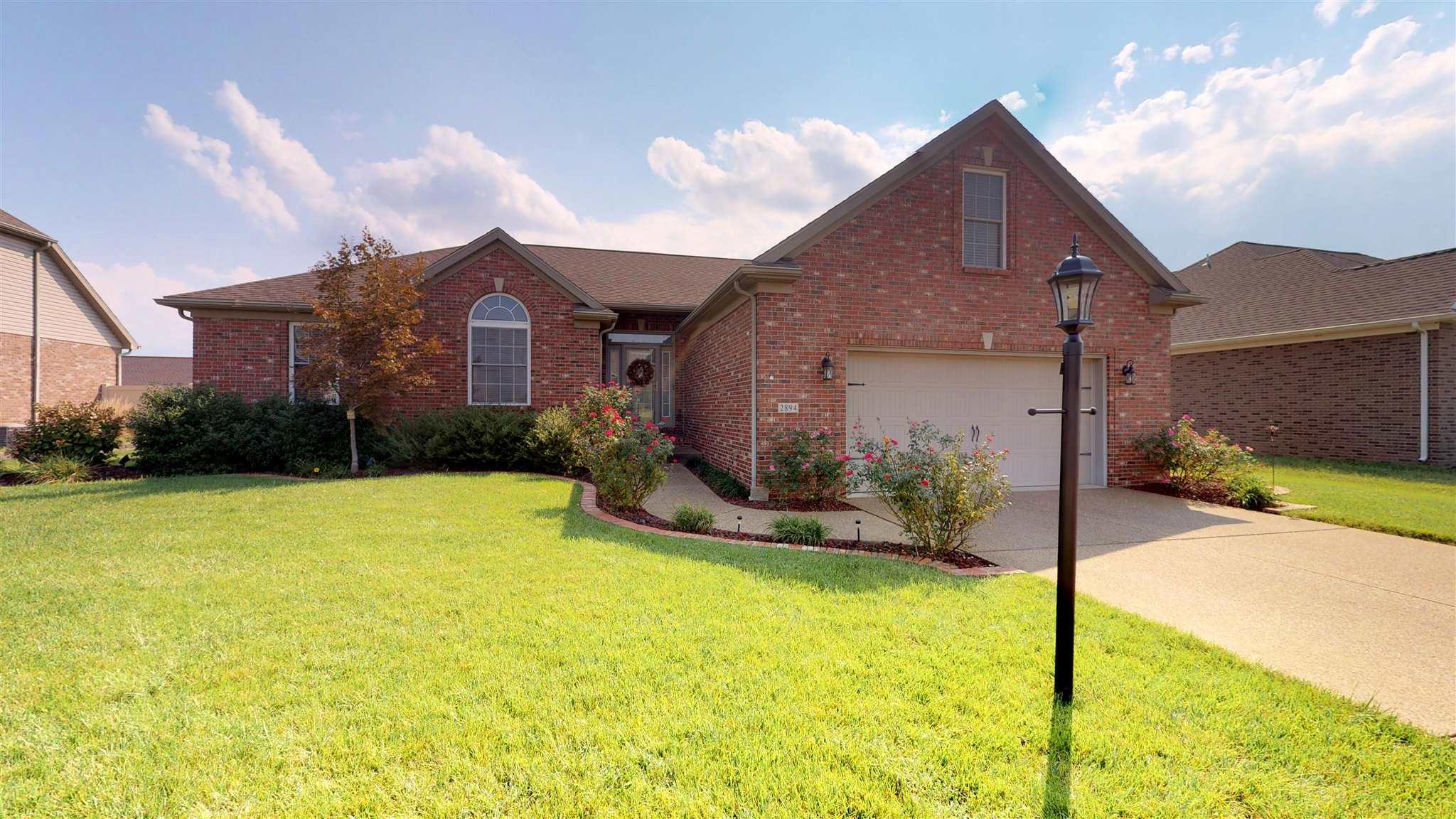 Open House Sunday 9/23/2018 1:00 - 3:00.  Fantastic ranch with a large bonus room.  Kitchen is spacious with great prep space and counter area, custom backsplash, lots of cabinets. Raised counter bar with room for barstools.  Kitchen is open to the family room and the extra large breakfast/dining space is all right there.  Plenty of room for formal dining furniture if you need it.  Great room features a vaulted ceiling with CF and a gas log fireplace with newly added decorative tile.   The back yard area has been upgraded by the current owner with plantings, extra attention to the deck system, added a stone patio & firepit area.  The master suite details beautiful tray ceiling, an over-sized walk-in closet and a large full bath with a double-sink vanity, walk-in shower, and large soaking tub. The two additional bedrooms offer nice sized closets and tremendous natural light. The main level of the home is completed by an oversized laundry room with a large closet, cabinetry for storage, and a utility sink. Upstairs the bonus/bedroom is oversized because the garage is so big.  There is attic access from the bonus room.   Bonus room does not have an actual closet.  The builder built this home for himself and there are lots of little upgrades that builders normally do for themselves including a roomier 25x25 garage.   Come see, you will be delighted.  Excluded: washer/dryer & curtains/hardware