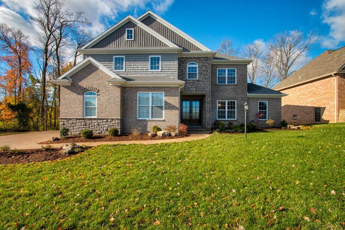 """Entering into 6299 Fieldwood Court is similar to the opening of an Architectural Design magazine. Situated on cul-de-dac with .43 acres in premier """"Woodfield Estates"""". You are certain to be surrounded by the latest custom looks available. 10' ceilings, 8' doors, & custom trims are just a few of the most desired features when building . Quality throughout!  No need to build for this one is BRAND NEW 2018. Formal living room w/ picturesque music room which offers much class with French doors & create separation between the rooms if desired. The curved staircase which at top overlooks the formal dining room leaves guest w/ a lasting impression.  Kitchen offering: Amish white cabinets  with Viatera quartz countertops , grey subway tile, pantry, triple windows above sink overlooking backyard & larger than life kitchen island for work space and seating.  The openness to the breakfast room with built-in wine cooler, the  great room with coffered ceiling, & sunroom w/ 14+ ceilings w/ gas fireplace bring this vast space all to together yet still exposed. (You will find the same finishes throughout this home  including: quartz countertops , Amish cabinetry, and 8' doors). The Master suite on main level showcases triple crown molding, custom master bathroom featuring free standing soaking tub & walk in tiled shower. There are separate vanities w/ quartz countertops & rectangle tile that add much style.  Your bedroom most likely be a place for much relaxation after the end of the day.   Master closest offers wood shelving as all closets throughout home. Tech closet and a terrific office w/quartz countertops overlooking backyard room are perfect touches to this superb layout.  The laundry room creates a space for every item wi/ separate zones for:folding, utility sink for washing, built-in locker station, cabinets for storage, & large closet for drying clothes or extra storage needs. 3 car side load  garage w/ utility sink & work area are located just off the laundry room. Upper"""