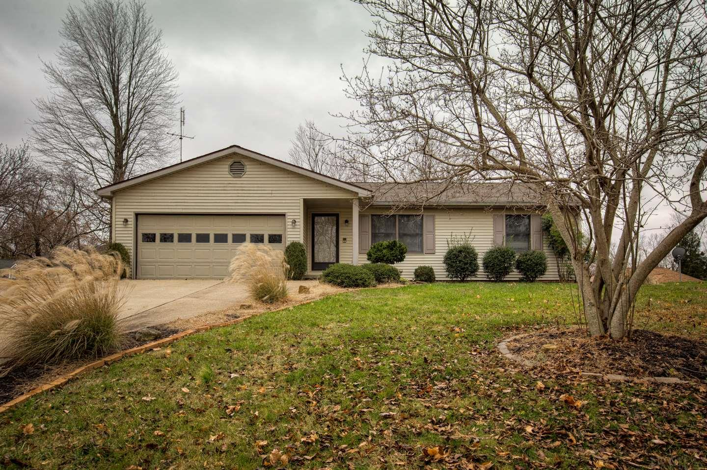 This beautiful lakeview ranch sits on 1 1/2 lots and offers a large kitchen with island and 2 living spaces with a fireplace.  There are also 3 bedrooms and 2 baths.  One of the bathrooms is off the master bedroom.  There is an attached garage with a small yard barn as well.  You are also within walking distance from the beach and recreation center.