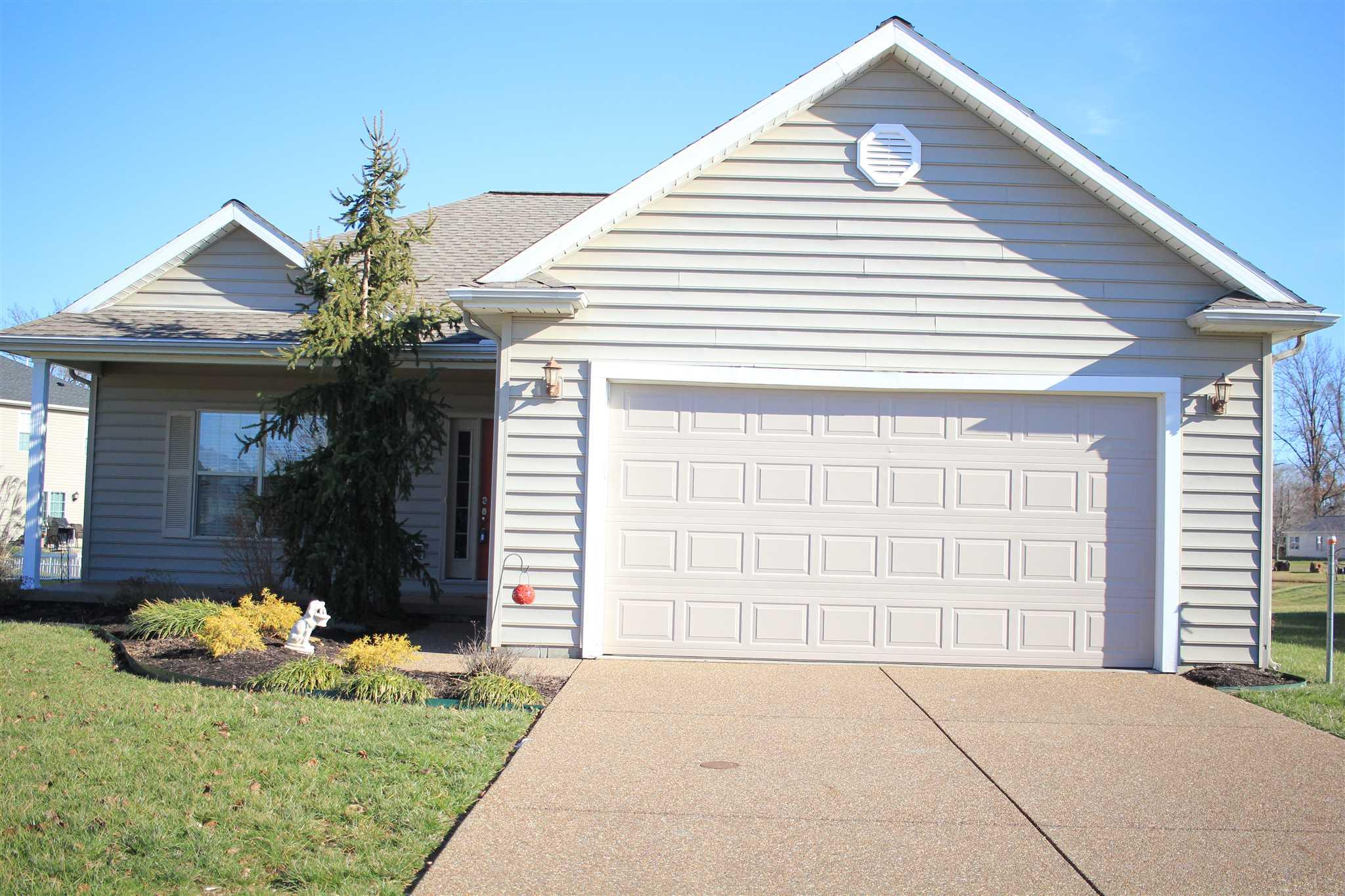 Great home ready for a new owner to love as much as the current owner.  You will be greeted by beautiful professional landscaping by Stocker's and a large open front porch. Step inside to a spacious great room that opens to the kitchen and dining area. Kitchen features:  castled cabinetry, a large pantry, stainless steel appliances, newer upgraded DW, MW, new faucet, under cabinet lighting, eating bar. Beautiful view from the dining area through the extra tall patio door.  Master bedroom has access to the covered back porch and has a view of the lake. Nice walk-in closet, master bath with double sinks, new step-in shower, glass block window, newer carpet. Other 2 bedrooms have large closets and are split from the master. Nice hall bath. Laundry room has shelving – front load Samsung W/D with drawers are included. Soft wall colors, 9' ceilings, finger groove molding. There is a new wireless garage door opener.  200 amp electric.  HVAC 2 years old, 98% efficiency with an Aprilaire Air filter. Relax on the covered back porch and enjoy the lake. Lot extends into the lake. Lovely home with a spacious feel.