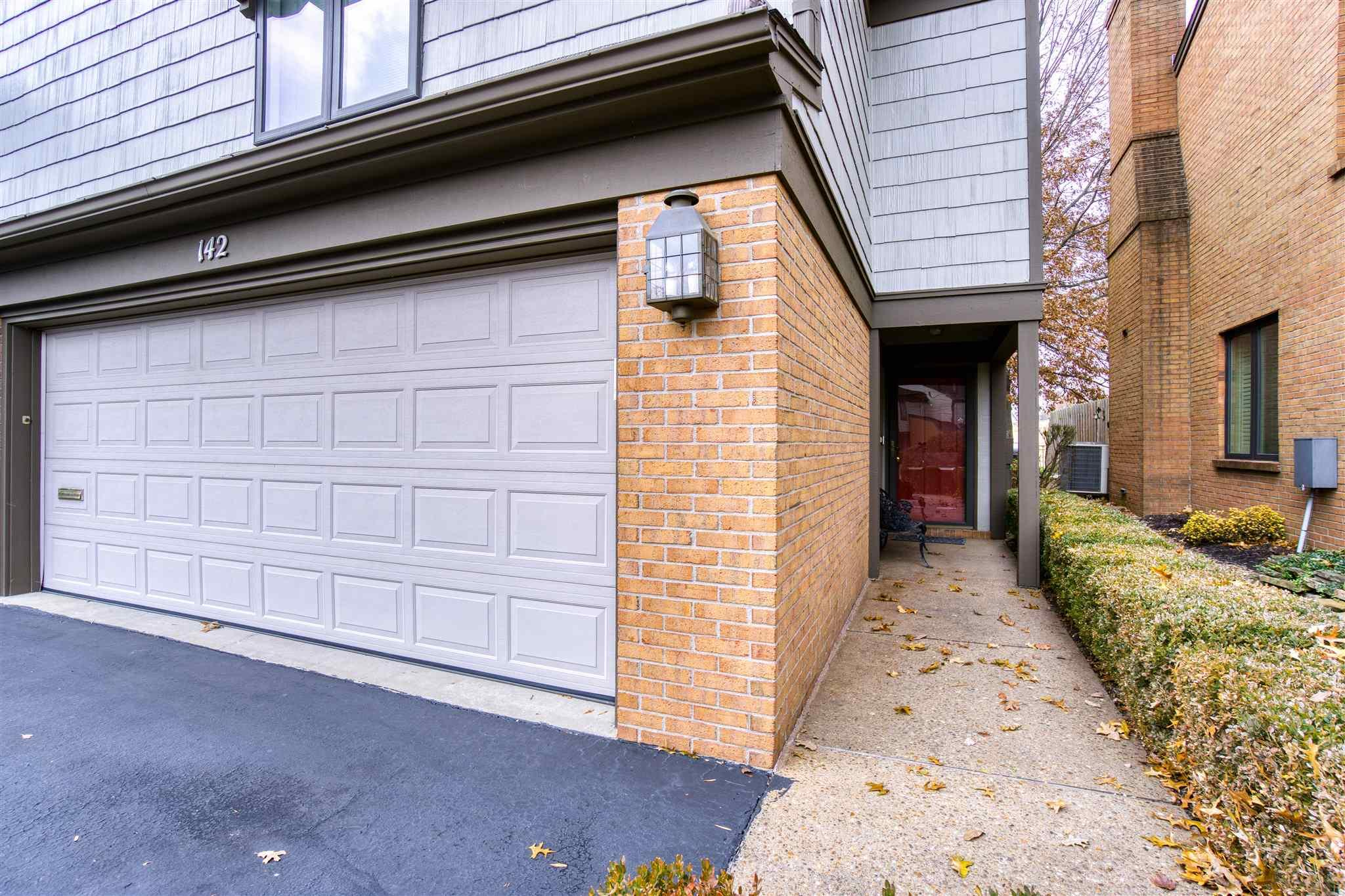 Beautiful second floor condo overlooking Evansville Country Club! The front door accesses the stair case that leads upstairs to the condo. At the top of the stairs, you're greeted by a large foyer that features a coat closet and a storage closet. The living room and dining room provide an open concept, access to the balcony overlooking the golf course, built-in bookshelves, and storage closets! The spacious eat-in kitchen has an island with breakfast bar. The laundry is located in the closet off of the breakfast area. The large master suite features a walk-in closet, linen closet, AND two additional closets! Storage. Storage. Storage! The private bath has twin vanities and a tub/shower combination. The second bedroom includes THREE separate walk-in closets! The third bedroom has TWO walk-in closets! You will not run out of storage in this condo! There is another full bath with a walk-in shower. Also features is a two car attached garage.
