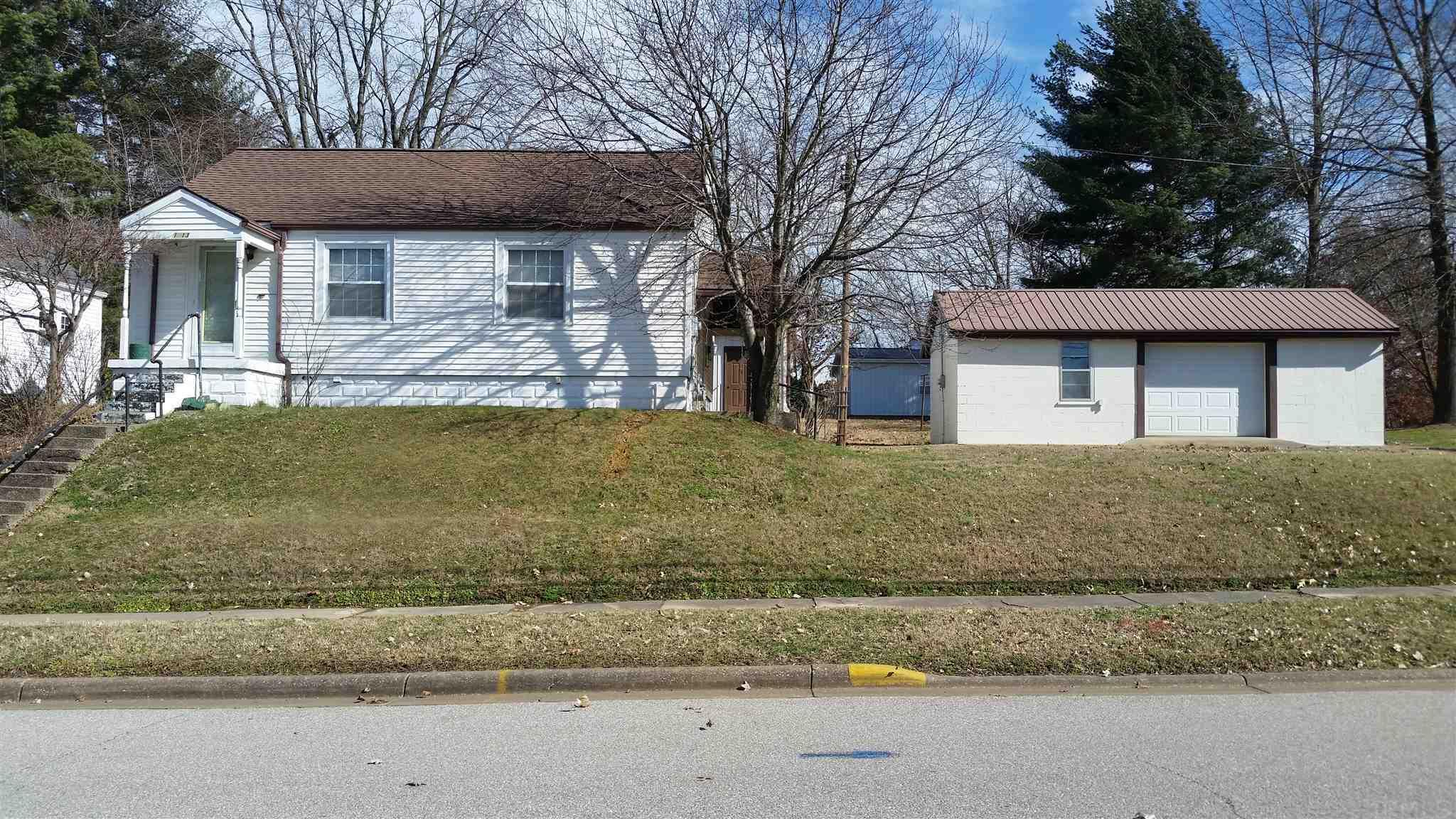 There are not many homes sitting on .35 acres in town, this one is. A home with 2 bedrooms, 1 bath, with a large living room, eat in kitchen and a full basement. Outside you have a 24x30, metal garage/shop and a 30x15 block garage/shop. There is a covered patio area and a large parking space available. A Perfect home for everything.