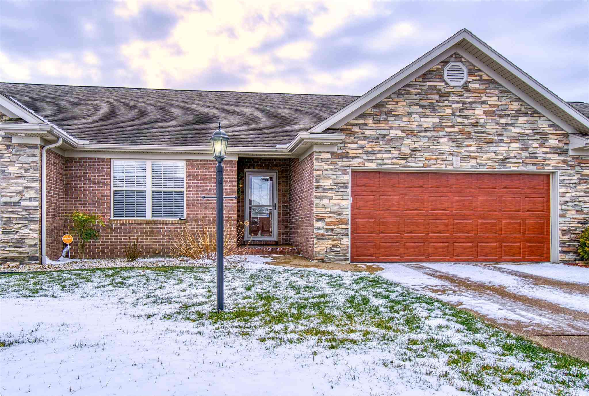 Check out this Newburgh condo on a lake.  This beautiful condo has 2 bedrooms, 2 full bathrooms, great room. large eat in kitchen and sun room.  The master bedroom has a walk in closet and a master bathroom with a jetted tub and vanity.  The kitchen has stainless steel appliances, granite counter tops and tile floors.  The sun room is glassed in for 3 season use and opens to the fenced yard.  This is a great area to read and watch the ducks on the lake.  There is also a laundry room and 2 car attached garage.