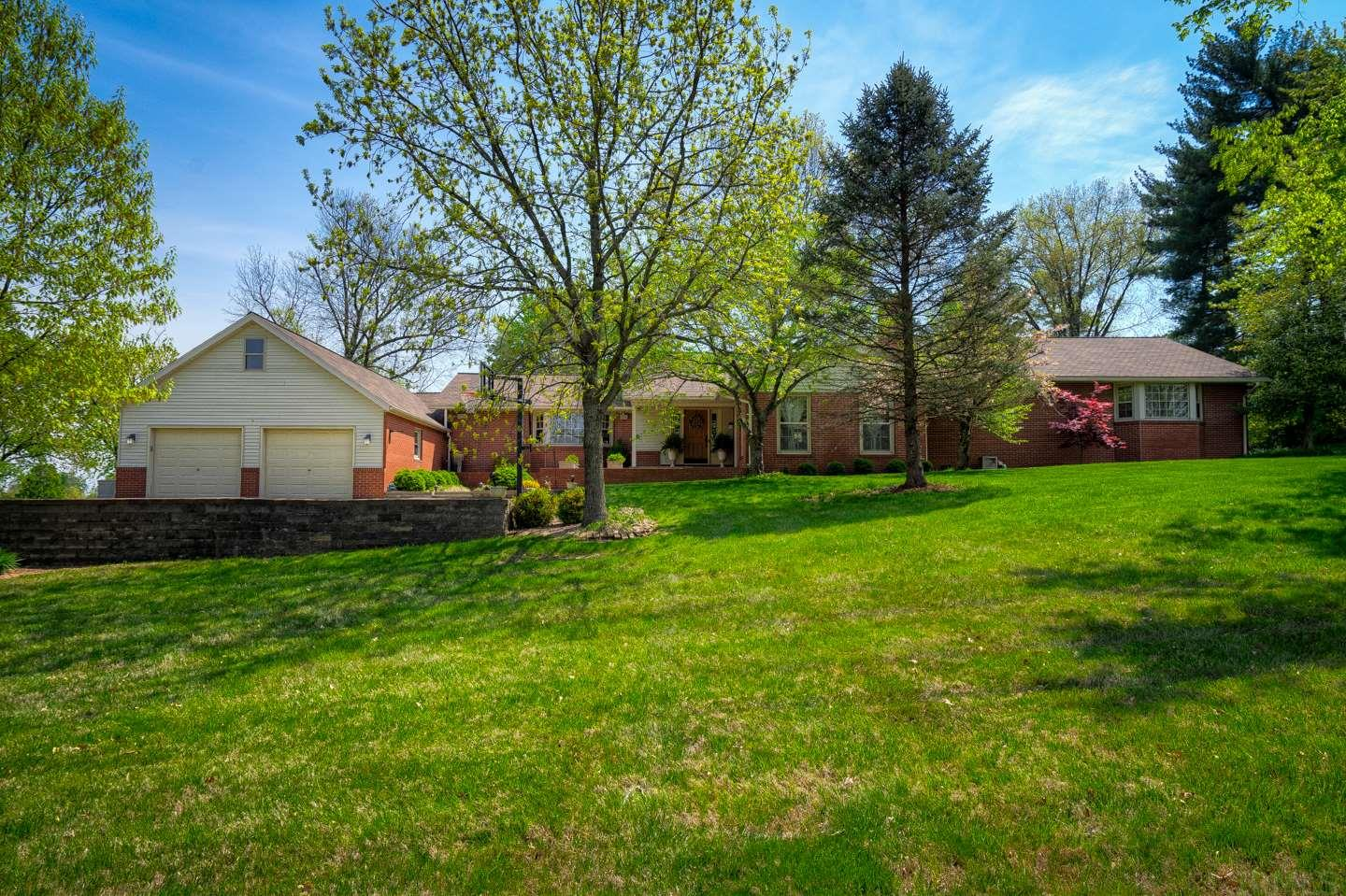 Welcome to this amazing modern ranch home! You will immediately be captivated by the oversized sunken family room and kitchen fit for a cook!  This 4 bedroom, 3.5 bath, one story home features 3,907 sq ft of living space.   There are 4 family/living areas plus an outdoor patio.  The spacious eat-in kitchen features an abundant amount of cabinets, granite counter-tops, center island with cabinets and double door pantry closets.  The screened in porch is a cozy retreat with slate floors, small built in refrigerator and a concrete countertop.   As you can see from the aerial photo, this home is just a hop, skip and a jump from the city park, city pool and League Stadium...home of Bombers Baseball!  Enjoy the many updates and wonderful location this home has to offer!