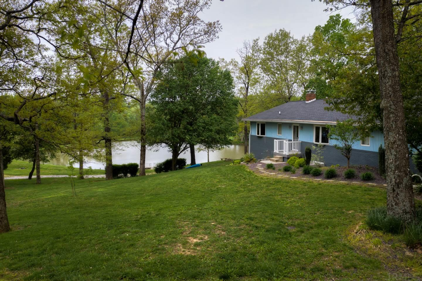 OPEN HOUSE - SUNDAY MAY 19TH 1-3 p.m. Eastern Time. New Reduced Price. Come out & see this very well maintained ranch home on 8 ACRES with it's own 1.5+/- acre lake in an extremely quiet & serene setting. Great country location and yet less than 3 miles to Ferdinand and less than 4 miles to SR 231. The large kitchen has tons of cabinets & counter top space & offers lots of room to cook & bake. The dining area allows space to stretch a table & host family holidays. From the very large and spacious living room walk out to the deck overlooking the lake and wooded acreage. What a great place to enjoy your morning coffee or an evening beverage after a long day at work. First floor laundry makes laundry a breeze. Enjoy the huge family and games room with wood burning fireplace in the finished lower level which offers new carpet & modern color scheme. The lower level bathroom offers a new vanity with beautiful granite top. There is a very spacious 2 car attached garage and a 24 x 24 detached garage that has been resided in the past 2 years. It also has a large 10 x 16 yard barn. There is a 21' pier for fishing or mooring your peddle boat & john boat which is being included in the sale. There is also a great 7 x 12 dock with rails for fishing or just sitting & enjoying the beautiful views. If you like to relax in a peaceful country setting this is the place is for you!!