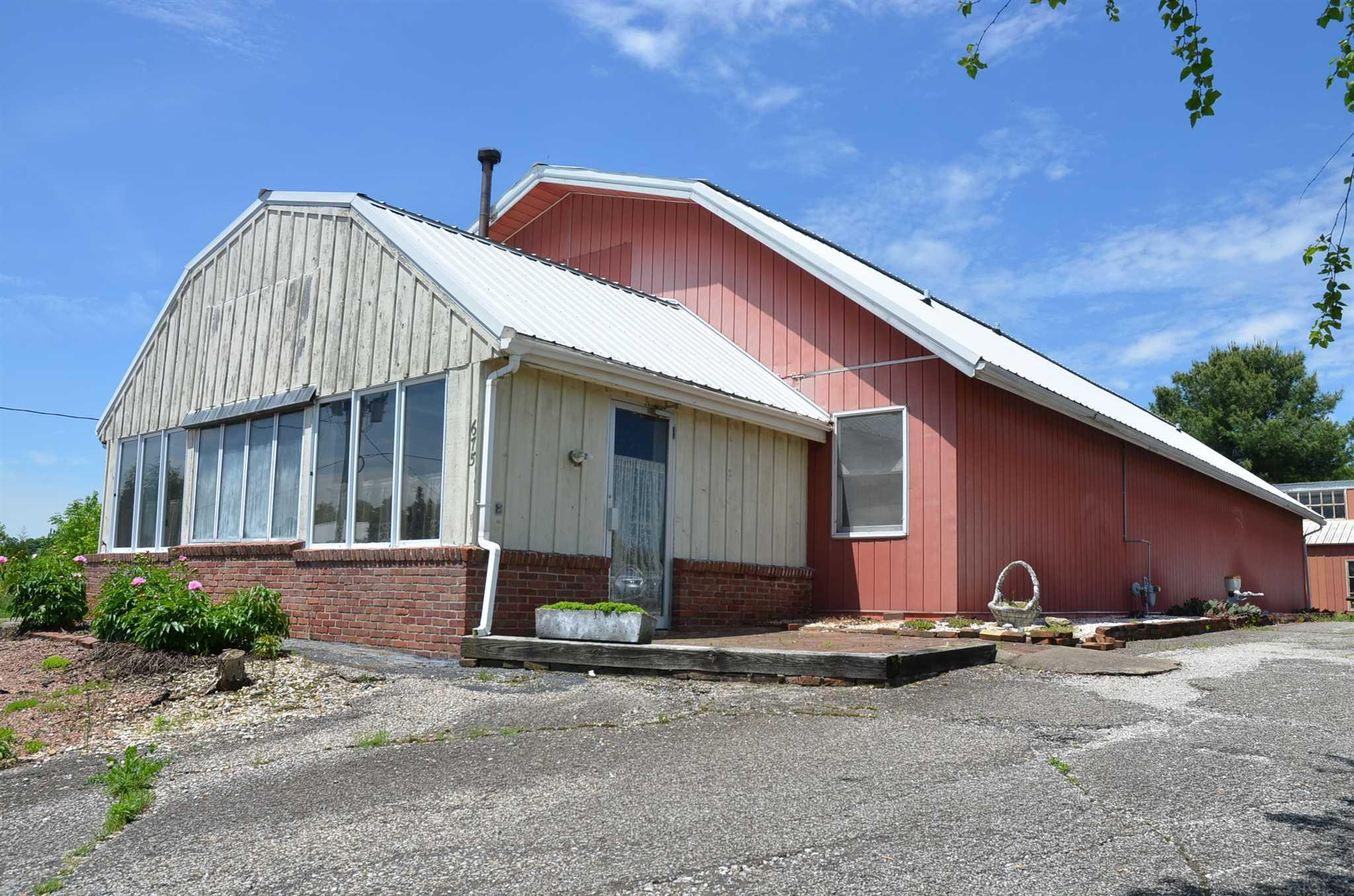 UNIQUE OPPORTUNITY!  This property is located along a blacktopped county road between Highways #231 and #162 on approximately 1.82 acres, and currently features one bedroom, 1 1/2 baths, large living/dining area and a small kitchen area.  This property was formerly used as a meat processing operation with large areas and three extra-large walk-in coolers that have a potential of being converted into bedrooms and additional living quarters and/or a business.  Includes an attached garage plus an additional detached garage/shop building.  The owners have passed away and the heirs want to sell...an opportunity waiting to happen!