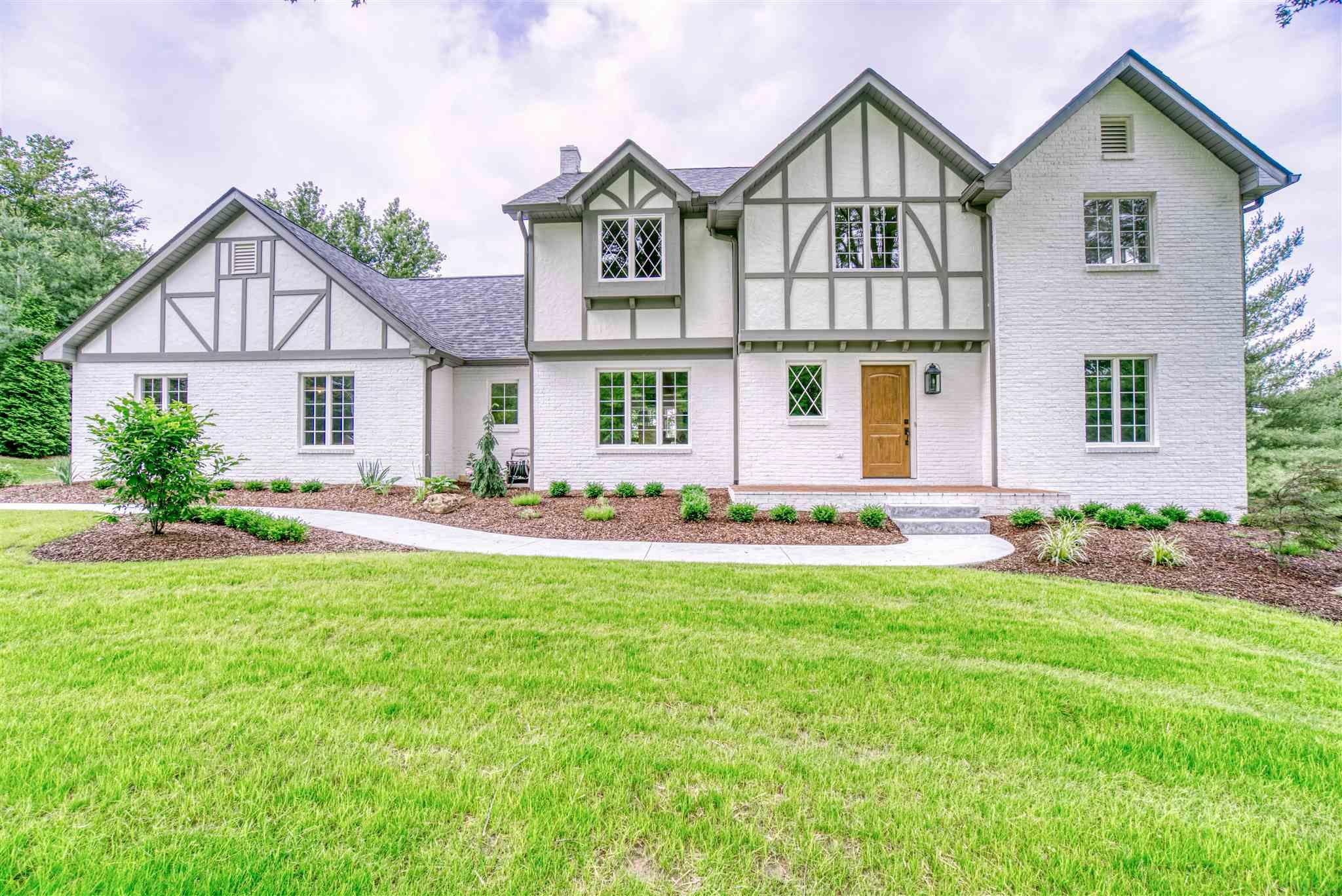 Welcome to the elegant St Charles Tudor! This home is a masterfully redesigned and fully renovated 4-bedroom, 3.5-bathroom Tudor Home that sits on 1.16 acres.  It is conveniently located to The Parklands, The Jasper High School, and the St. Charles walking/biking path.  Every detail in this home was carefully selected and quality crafted. The main floor plan encompasses a beautiful kitchen with custom built cabinets, stunning soapstone countertops and new Kitchen Aid appliances. The kitchen flows into a functionally designed mudroom, laundry room, a half bath, a dining room and living room. The living room is graced with a beautifully trimmed wood burning fireplace, large windows, and opens up to a custom-built wood deck. Finishing the main floor is a spacious study and a custom staircase which leads you to the upstairs. The upstairs contains 4 generously sized bedrooms and 2 full bathrooms. The master suite has a large walk-in closet, additional his and hers closet spaces, and a beautiful master bath with a custom tiled walk in shower.  Three additional bedrooms, a full bathroom and another study with built-in cabinetry finish off the upstairs. The basement is a perfect open space for entertaining with a bar, built-in entertainment area, and a full bath and opens to walkout patio. There are too many features to list.  Please come check out your new home.  Created and Designed by A + D Renovation and Design.