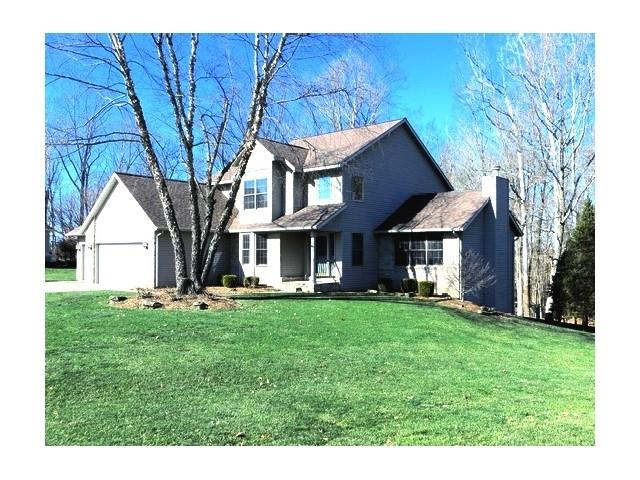 Enjoy the privacy and serenity of this 4 Bedroom 3.5 Bath home on a beautiful wooded lined lot.  The two levels of decking, a patio, and a screen porch provide an abundance of outdoor living to relax and entertain. The convenient screen porch is off of the master suite and deck. Imagine yourself relaxing on the screen porch taking in the cool evening breeze watching the sunset. This home has had loving care and many updates since 2012:  a roof, additional attic insulation, up and down furnaces, up and down air conditioners, entry doors, carpet. mud room cabinets, and new kitchen cabinets with granite counter tops. This large kitchen has a working and eating island, abundance of pantry space, special toe kick drawers and stainless steel appliances. The breakfast room is lined with windows to enjoy the beauty of the backyard.  The spacious great room has cathedral ceilings and adorned by a brick fireplace with a beautiful wood mantle and trim. There are three bedrooms, a full bath and study space upstairs.  Two laundry rooms for your convenience one in mud room on the main level and the other in the lower level.  The basement is just that a lower level lined with windows and doors . It has a hobby room that could be a guest bedroom, a game space with a built in entertainment center and book shelves, a sitting area, a wet bar, a full bath, laundry and storage room. There is a three car garage and a spacious driveway with lots of parking space.  Located on .95 acre lot on a quiet dead end street this home should check all the boxes on your want list.