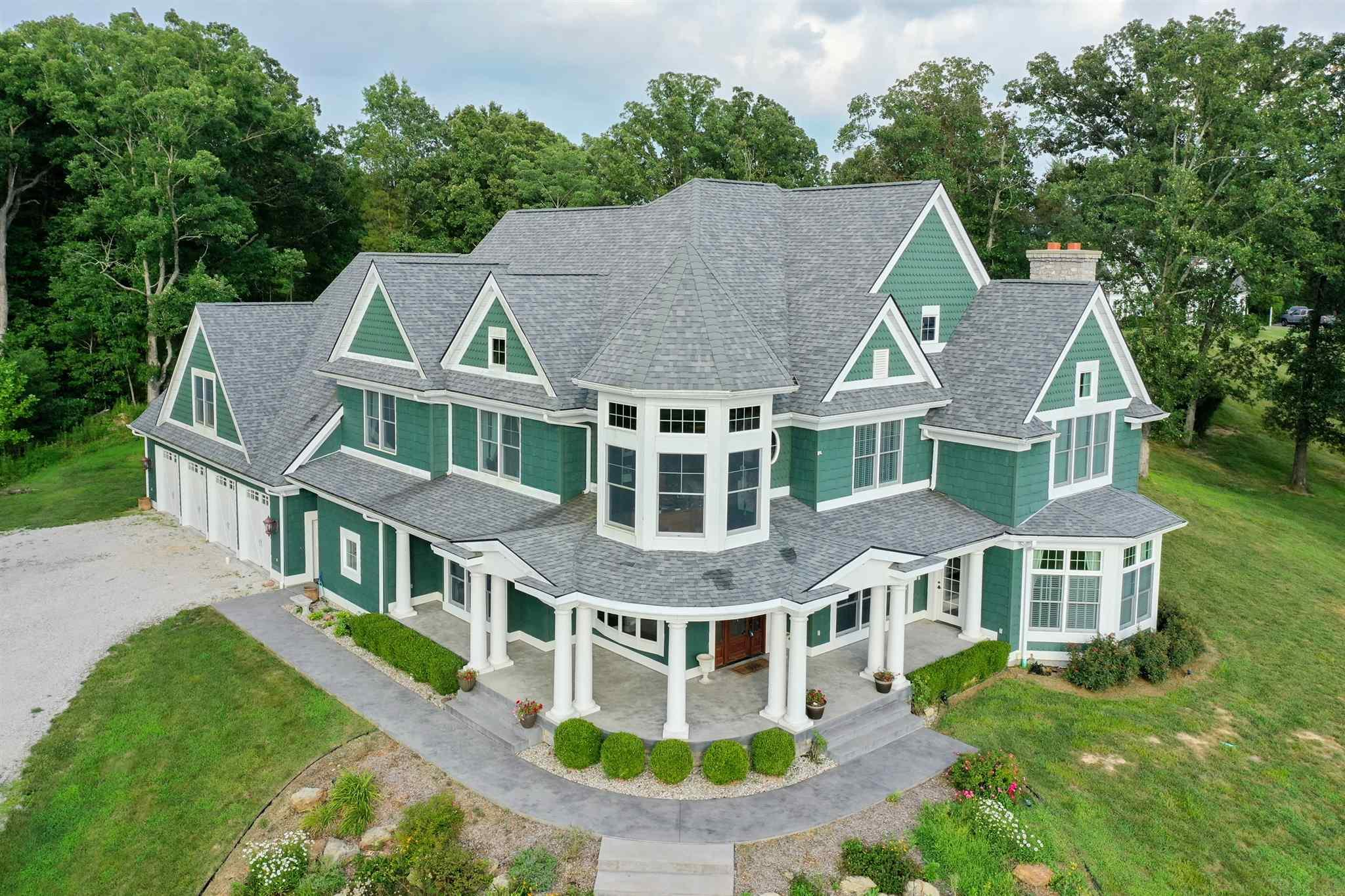 """The Finest of Everything! Gorgeous New England style with European flair and elegant interior, built around rotunda in center of home.  Amazing lake front views and private boat dock. Just to mention a few things...Home built using ICF Construction; 65' long garage with 4 car bays and 5th door for mowers; Floors made of Travertine, Marble and 3/4"""" solid Black Walnut; 2 wood burning fireplaces (plumbed for gas) with hand carved marble mantles; GeoThermal HVAC; Amish built Oak curved staircase in rotunda with marble columns; Kitchen with top of line Mastercraft cabinetry, Granite countertops, Travertine backsplash, 2 copper sinks, 6 burner gas cook top, 2 wine coolers, double ovens, walk in pantry; Laundry on main level and upstairs; Enormous bonus room/Man Cave; Large windows, high ceilings, amazing views!"""