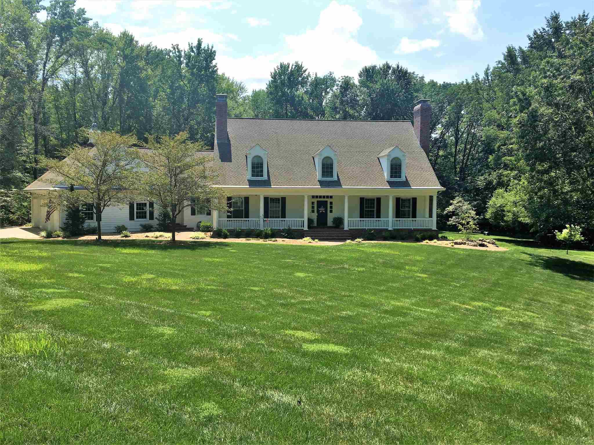 "Classic Cape Cod style custom built home by Randy Elpers. Tucked away at the end of a cul-de-sac this home offers privacy and seclusion amongst nature. Welcoming covered front porch is surrounded by new landscaping and brick walkway. Walk in the front door and you will immediately notice the attention to detail in this spacious home. Gleaming hardwood floors through-out most of the home. The entire home was built and remodeled with Fehrenbacher custom cabinetry, crown molding, wood trim, baseboards and solid wood doors. The inviting 2 story foyer opens to the LR with gas log fireplace and the elegant formal DR. The Den features solid natural cherry panels with built-in bookcases, a built-in desk and gas log fireplace.Updated eat-in Kitchen is a chef's delight with Quartz tops plus a center island eating bar and a walk-in pantry. Thermador appliances with a 6 burner gas range/hood, double ovens and heat lights to keep food warm. The Kitchen is open to the Great room making it ideal for entertaining. Main level Master BR with high ceiling adjoins the Master BA which is complete with dual vanities, walk-in tiled shower, marble floor and walk-in closet. The guest half bath and laundry room completes the main level. Front and back stairs allow for easy access to the 2nd level. Upstairs you will find 3 oversized Bedrooms and a Bonus Room. One BR features a private full BA with tiled shower. The other 2 BRs share a Jack and Jill bath. The Bonus room is a great area for kids. The walk-out LL, remodeled by Randy Elpers in 2017, includes a media area with 105"" TV screen, stone fireplace, game area and high top bar, cabinets and granite tops. Entertaining will be easy with a full size DW, refrigerator and a wine cooler. The 5th BR has easy access to the full BA. French doors open to the side patio and yard. You will love spending time on the screened porch and patio with outdoor grilling space. This is truly a special home. Complete list of updates/details in the home."