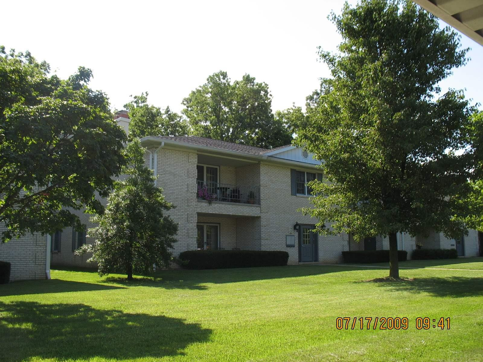 Excellent first floor location.  Beautifully decorated and updated with 1868 sf.  Seven rooms include:  Master bedroom w/walk-in shower, guest bedroom and full guest bath, living room w/wood burning fireplace and electric insert, formal dining room, kitchen, family room/den and laundry room with washer/dryer.  Unit has great traffic flow, low utilities and fees.  Carpet, tile and wood floors.  All window treatment/shutters, ceiling fans and chandeliers are included as are range, refrigerator, microwave, dishwasher, disposal, compactor, fireplace window/screen.   The 24 hour Clubhouse features an indoor pool, spa, men and women's saunas and dressing rooms, a well equipped fitness center, billiard/table tennis room, library, party room, WiFi. Patio w/grill and a championship tennis/pickle ball court.  $298 monthly homeowners association fee includes: cable tv plus all exterior maintenance and improvements to the buildings and grounds, exterior window cleaning, landscaping, snow removal, two assigned carports and full use of the Clubhouse.  2019 payable real estate tax, w/homestead exemption is $1393. Monthly electric average $92, per Vectren. $46 average per month for water/sewer, per HOA ****Room sizes are approximate****