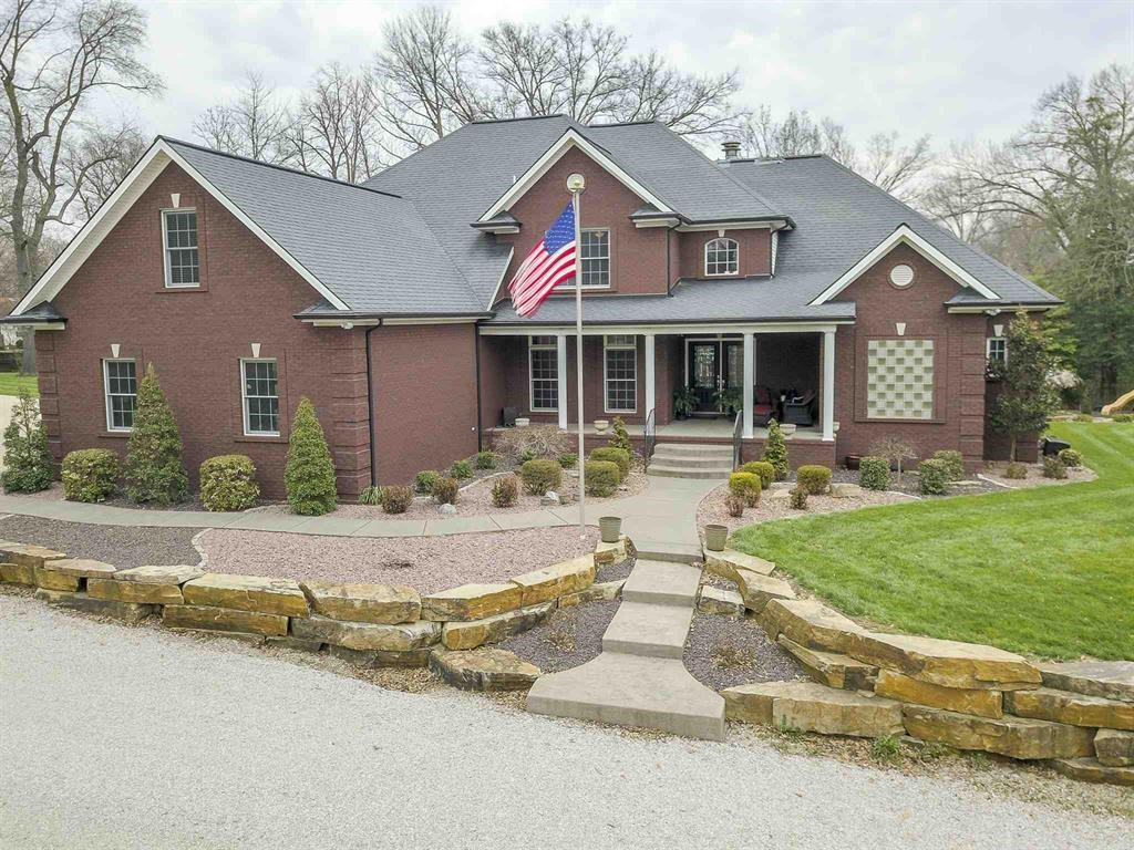 This one owner custom house is incredible! Tucked behind the trees just off Stringtown Road, on just under 2 acres, it feels like you are in the country, and yet you are just minutes from shopping, eating, and entertainment.   As you walk in to the large foyer you are met by an amazing great room with cathedraled ceiling and huge windows that look out over the pool and grounds. A fully equipped large eat in kitchen with 2 pantries, abundant storage, granite counter tops, 5 burner gas range, double ovens, warming drawer and more. The first floor master has an office, an amazing, huge his and hers bathroom that will blow your mind, with double shower, double walk in closets bathroom, heated floors, and cool lighting, There are 3 bedrooms on the 2nd level all with their own bathroom and walk in closet, every attention to detail has been considered. The fully finished walkout lower level is fabulous, with a full bar, dishwasher, refrigerator, microwave, wood burning double sided fireplace, family Room, game room, wine cellar/safe room, covered porch, and full bath! Laundry rooms on the main and second level. An over sized 3 car garage. The amenities are too many to list, but include: an elevator to all 3 floors, 400 amp service, dual on demand water heaters, salt water pool, sprinkler system, 2 entrances (one gated), even a chandelier that lowers itself for cleaning. It will feel like you are on vacation year round!