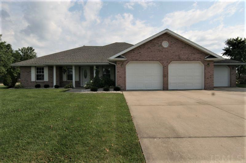 Situated on a .35 acre corner lot is this 1786 sq. ft. all brick ranch style home. Features include 3 bedrooms, 2 full bathrooms, and a 3 car attached garage. This home offers an open concept floor plan as well as a split bedroom plan. The kitchen features an eat-at-bar with granite counter tops, a tiled back splash and is equipped with all of the appliances including a trash compactor. The spacious master suite includes a large walk-in closet and has several access doors to the garage as well as wider handicapped doorways. This home is upgraded with many extra's including heated floors, irrigation system, glassed in porch, a jetted tub,  a Sun Setter awning over the patio, and a utility shed. A bonus is the pretty landscaping and convenient location