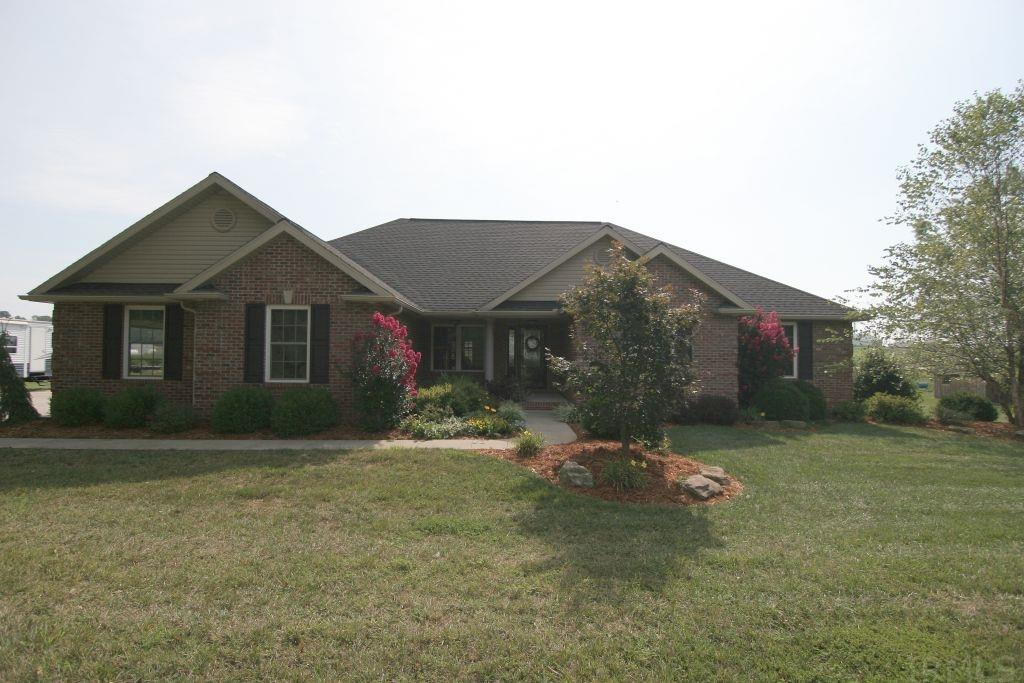 If you are searching for a newer home with 3 bedrooms, 2.5 baths and a full basement over an acre of land, then your search may be over.  This all brick 2011 built home spans 2025 square feet plus a full basement with an egress window.  As you step inside, you will instantly enjoy the open concept with trey  ceiling, ceiling fan and custom built entertainment center which the Sellers are leaving.  The beautiful custom kitchen cabinets also include stainless steel appliances.  The spacious master bedroom suite features his and her vanities, walk-in shower and a walk-in closet.  Two additional bedrooms and a full bath with double basin vanity are located around the corner from the master bedroom. The spacious main level laundry room and folding ares are located justify of the kitchen.  As you step inside the house from the attached two car garage, you will enjoy the custom drop station which is also included.  Venture downstairs to watch a movie or your favorite sporting event with the projector and screen.  The basement is roughed in for a full bath just incase you decide to had a fourth bedroom in the basement.  Geothermal heating and cooling makes this property inexpensive.  Step out back to sit on the cover front or back porches or  the open patio area.  The storage barn and playset are also included.