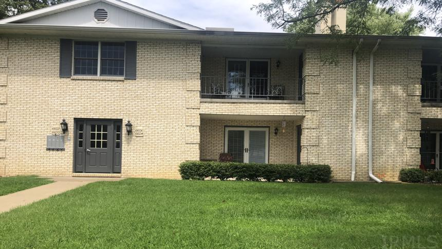 This lovely condo on Newburgh Road is looking for a new owner! Come see this 2bed/2bath condo on the east side of Evansville. HOA fees are $288 monthly, which includes access to an indoor pool, Whirlpool, fitness center, billiards room, and outdoor tennis courts. After you enter this brick-exterior condo building, you'll find 6606 on the second floor. This home features exceptionally large rooms, starting with the living room just past the entry foyer. This room boasts a beautiful brick fireplace and a set of French doors that leads to the covered balcony. Overlook the complex and enjoy a gorgeous view of the open sky while relaxing on this balcony! If you reenter the home and continue to the right past the living room, you'll come across a well-lit formal dining room that connects the kitchen and family room. The kitchen offers more than enough lighting and newer vinyl flooring. You'll also be pleased to know that the refrigerator, microwave, dishwasher, and electric range are all included with the home. Just across the kitchen is the separate laundry room, but it could also double as a private office or storage area. Along with the washer and dryer hook-ups and breaker box, this room features a plethora of built-in storage cabinets. Further down the hall lies the first full bathroom and a large family room. You'll love spending time in this spacious area of the home, especially with its built-in surround sound system and sizable bar. The theme of spaciousness continues with the two bedrooms found just past the family room. The first room features a ceiling fan, large closet, and two large windows with included window treatments. The master bedroom is even bigger and offers two closets (one is a walk-in) and a beautiful private bathroom with tile flooring, wide sink countertop, and a large shower room with a tub/shower combination. As you can tell, this condo is very roomy and would be perfect for a number of occupants. Come see it in person before it's too late!