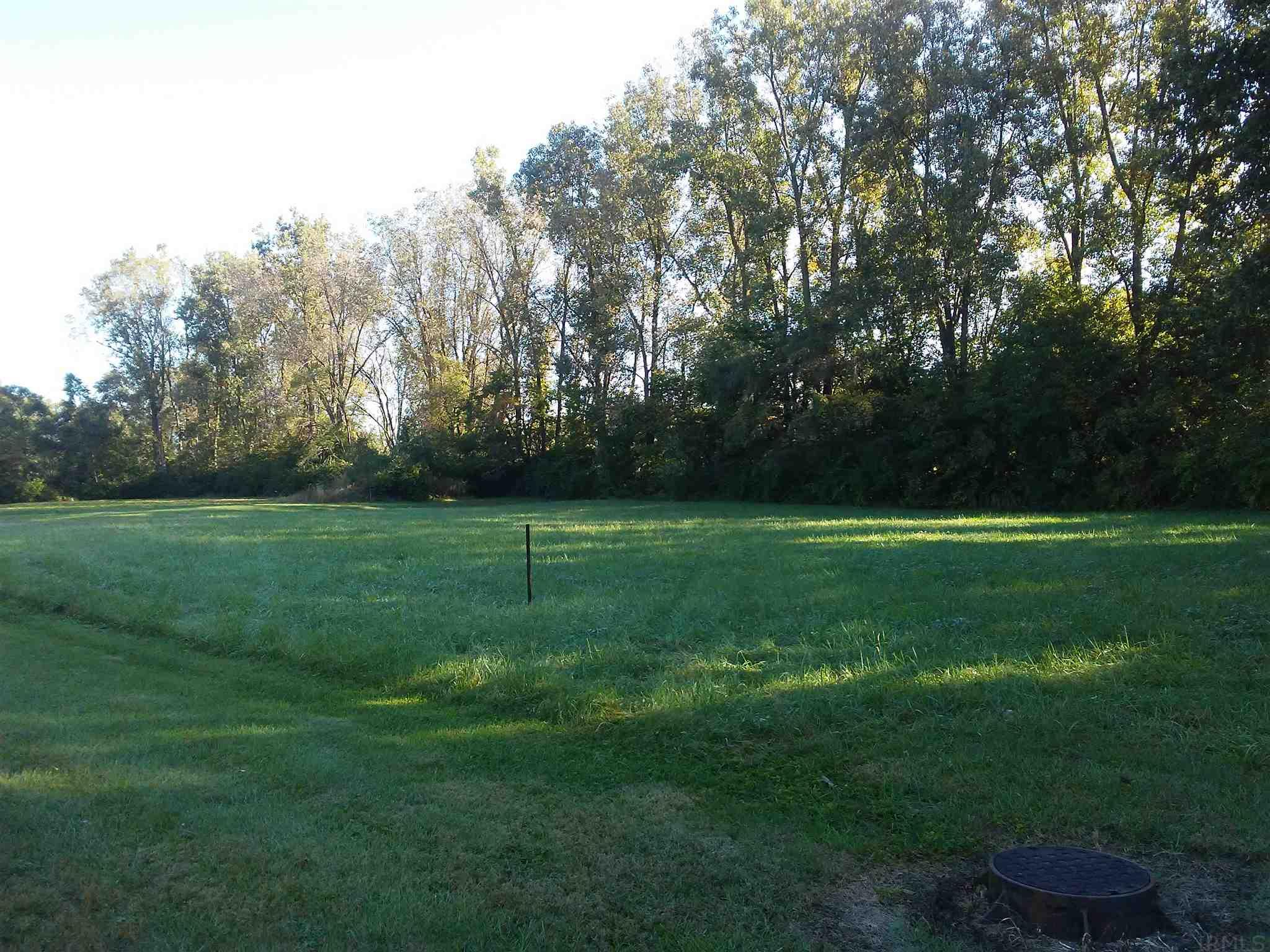 It will be easy to forget you are in the city with this one acre of land.  It is located in a quiet and peaceful neighborhood.  There are homes across the street recently built.  There is potential to separate into 2-4 lots or keep one large area to build your new home, or both.  The property backs up to a wooded area for added privacy.  All city utilities available.