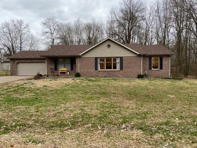 Great 3 BR ranch home offer 1600+ sq. ft., split bedroom style with large open living room with newer flooring.  2 tiered deck and storage building as well as large attached garage and front covered porch.  Offers a great location with plenty of yard space and low traffic area.