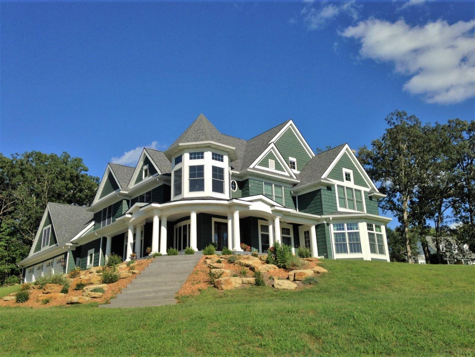 "MOTIVATED SELLER! This majestic, spacious Victorian home sits on 1.3 acres atop a hill overlooking Christmas Lake, and watches the sun set behind the water every night. The magnificent 23+ foot tall rotunda surrounded by the winding staircase is the centerpiece of this impressive home. The flooring on the main floor is all travertine, marble, and 3/4"" solid black walnut. The spacious kitchen features custom cabinetry, granite countertops, 2 copper sinks, double oven, 6-burner premium gas cooktop with ultra low settings, and walk-in pantry. The open great room just off the kitchen has a fireplace plumbed for gas, with a custom, hand-carved marble mantle, made in Europe. The sitting room/study has a 21+ foot ceiling, abundance of windows, and second fireplace, plumbed for gas, with custom, hand-carved marble mantle. The dining room with custom-made chandelier, den, spacious laundry room, and two half bathrooms complete the main floor. Upstairs you will find a sprawling master suite,with vaulted ceiling, and breathtaking view of the lake. The master bathroom showcases a Hydro-massage tub, double-bowl vanity, walk-in shower, and walk-in closet. Two more bedrooms share a Jack-n-Jill bathroom, and the 4th bedroom has it's own bathroom. The second den with bay windows could be converted into a 5th bedroom. Upstairs you will also find a huge rec room with theater area that would be a dream play zone, for kids or adults! There is also a second laundry room area. Want even more space? The full, unfinished basement is plumbed for a kitchen and full bathroom, and is an empty canvas ready for you to paint your own masterpiece. The enormous 4-car garage has plenty of additional space for mowers and tools. This house was built with two stories of 6"" thick, insulated concrete form construction. This home also has geothermal HVAC and access to a private boat dock. Area amenities include golfing, boating, fishing, quick access to Holiday World, and top tier Blue Ribbon school system. You will feel like you are on a permanent luxury vacation living in this gorgeous home."