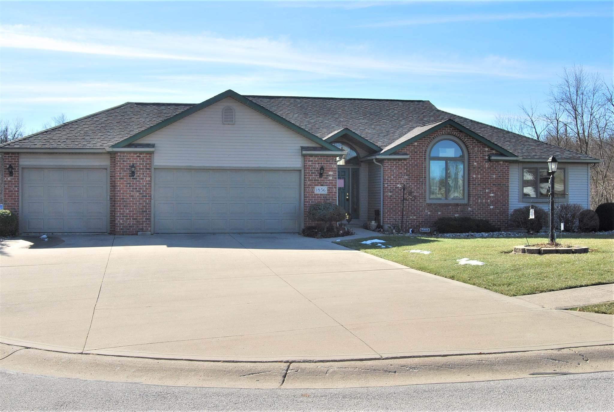 Gorgeous ranch style home featuring 3 bedrooms,3.5 baths on a full finished walkout basement on a Cul de Sac! Amazing southern view on the golf course on half an acre.  As soon as you enter the front door you will appreciate a grand living room with a cathedral ceiling and gas log fireplace. The efficient kitchen features a heated ceramic tile floor and Cambria Canterbury counter tops. Off the dining area is a warm sun room for your morning coffee, or if it's really warm, go out onto the deck. The master bedroom has plenty of space for that King sized bed and has an incredible en suite bathroom with jetted garden tub and shower. The walkout basement affords a game room, home theater area, a bathroom, storage and/or whatever your imagination can create(man cave!). Heating, cooling, water heater,water softener, roof and most of the appliances are recently updated.The spacious three car garage is ready for toys!