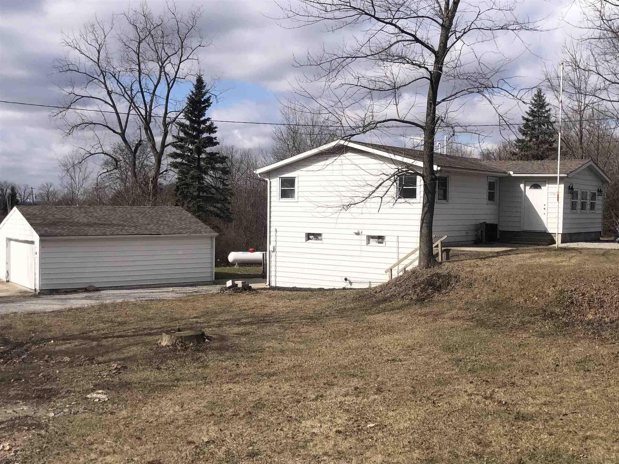 This cute lake home is available right before summer time! This home features amazing hard wood floors, a huge master bedroom closet, a new well, a newer roof, and endless potential for the unfinished walk out basement! Do not miss out on seeing this beautiful home.