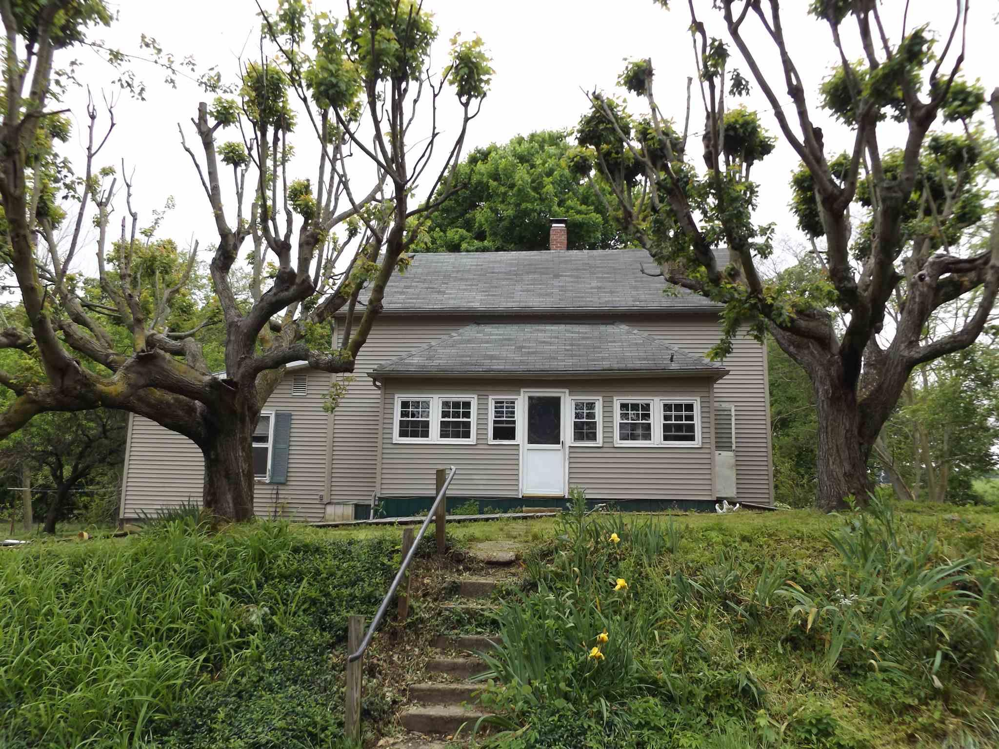 Beautiful setting and location. A 1910 4 square home sits in the middle of this 1.82 acres of heaven. Buildings and home needs TLC. Mature fruit trees and garden area.