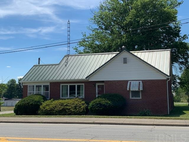 Spacious Brick Home Located On Main St. In Ferdinand.  Situated on .41 Acre Lot This Home Features 1804 Finished Sq. Ft.  On The Main Level Is A Spacious Kitchen And Dining Room With A Sliding Door Leading Out To A 28 x 16 Deck Overlooking The Large Backyard.  Living Room With Large 3 Panel Window Lets Plenty Of Sunlight In.  Off The Living Room Is A Den/Home Office With Hardwood Flooring. Main Level Master Bedroom Also With Hardwood Flooring And Spacious Bath With Separate Garden/Jet Tub, Walk In Shower And Walk-In Closet Completes The Main Level.  37 X 11 Upper Level Bedroom With 2 Closets And Half Bath.  Full Basement, 9 X 16 Enclosed Porch And Detached Garage. Deck Was Added In 2018, Some Replacement Windows, Electric Updated And Front Door Replaced.  Don't Miss Out On Viewing This Charming Brick Home!