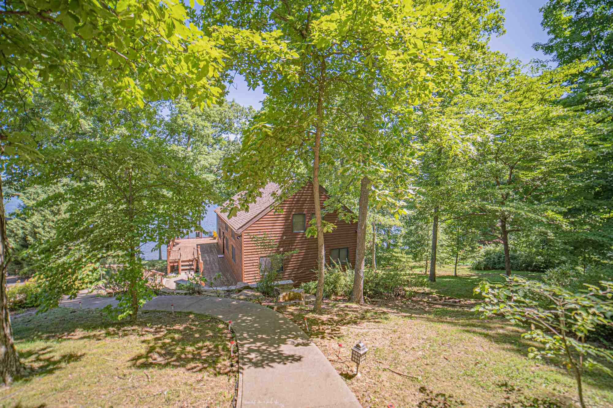 Christmas Lake Front Living at its best!!! This 3 bedroom, 3 1/2 bath Yankee Barn home is nestled in the woods over looking Christmas Lake!!! This home continues to have lots of the original charm, along with many updates! Walk into the spacious great room with beautiful cathedral ceiling, wall of windows offering gorgeous views of the water, and floor to ceiling fireplace. Open concept living to the great room and kitchen area. Granite counter tops and stainless steel appliances.The main level also offers a dining room area, master bedroom with ensuite and another bath on this level. The upper level consists of a loft area, two bedrooms and a bath. Lots of natural lighting through out this beautiful home. Hardwood flooring in the home as well.Spacious Trex deck and screened in porch area. Imagine relaxing and or entertaining on this wonderful area over looking the beautiful waters of Christmas Lake! Full walk out basement with tremendous storage and a bathroom. Private boat dock. What are you waiting for?.... Paradise awaits!!!